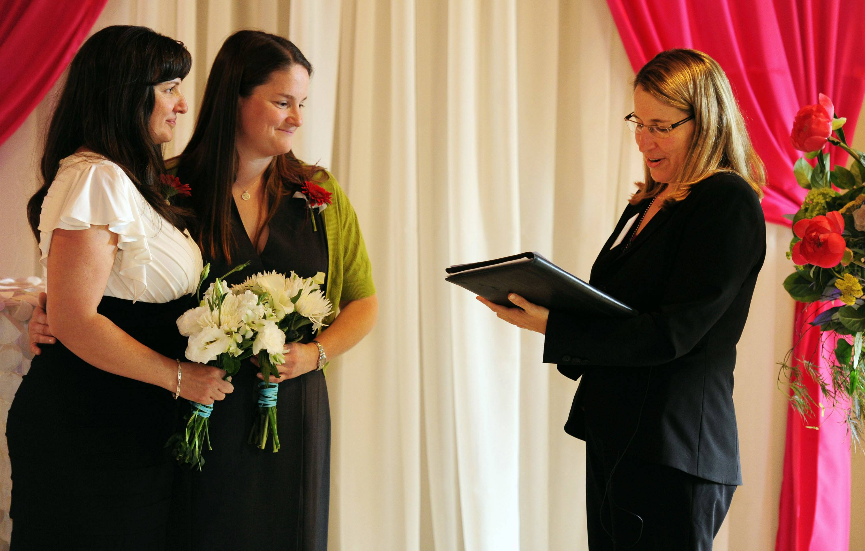 Julia Fraser, left, and Jessica Rohrbacher get married by Holly Pruett at the Melody Ballroom in Portland, Ore. on Monday, May. 19, 2014. Federal Judge Michael McShane released an opinion Monday on Oregon's Marriage Equality lawsuit that grants gay and lesbian couples the freedom to marry in Oregon.