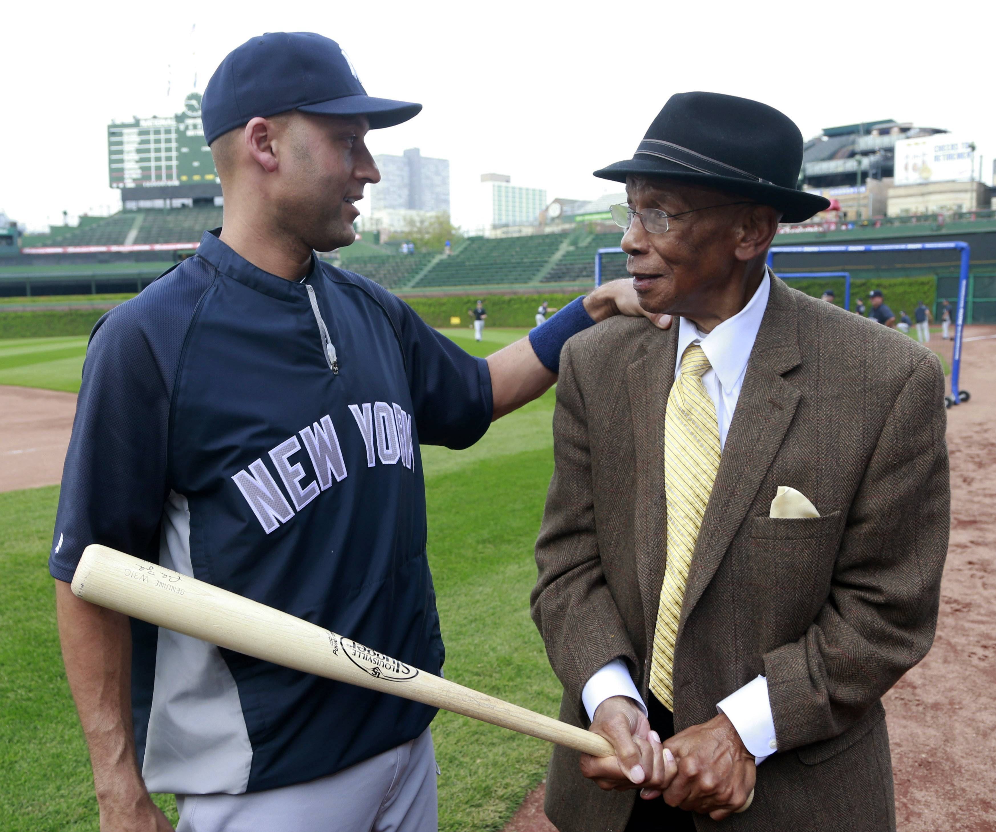 Yankees shortstop Derek Jeter, left, talks with Cubs Hall of Famer Ernie Banks before Tuesday night's game at Wrigley Field.