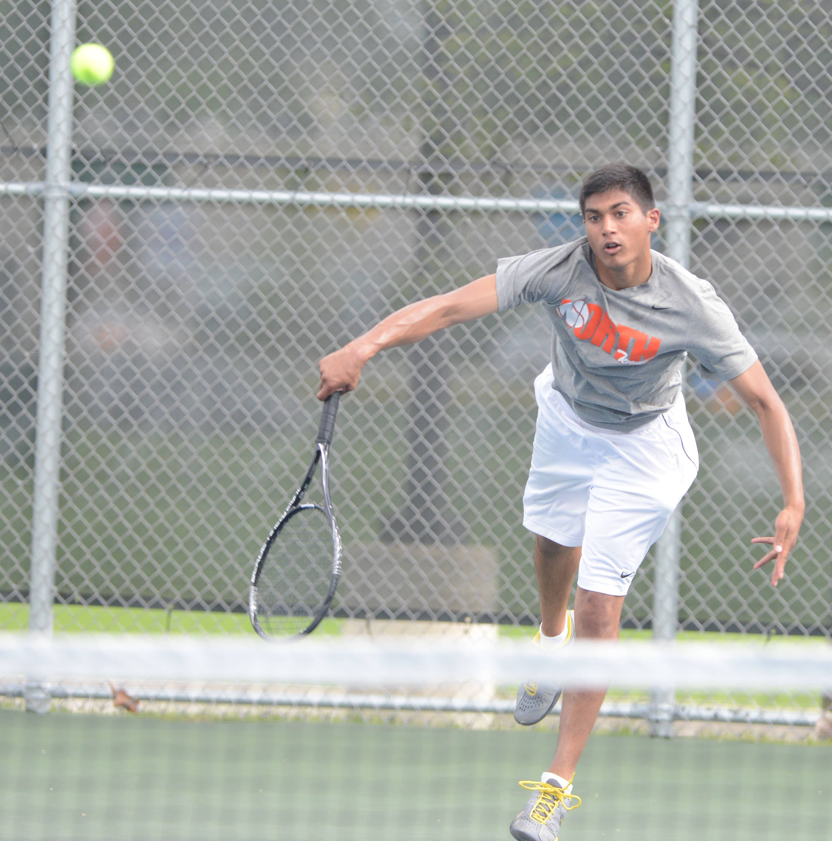 Amit Iyer of Neuqua Valley works the ball during the Naperville North boys tennis meet Tuesday. He is a #1 singles player.