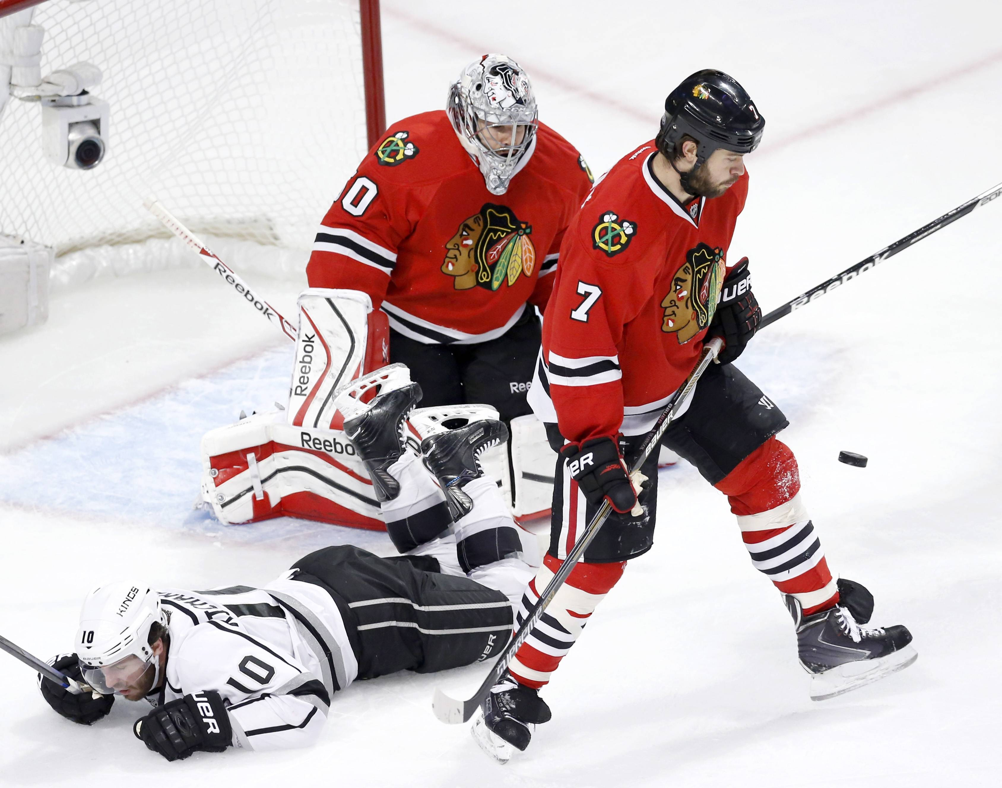 "In this photo taken Sunday, Chicago Blackhawks defenseman Brent Seabrook (7) deflects a shot on goal away from goalie Corey Crawford (50) as Los Angeles Kings center Mike Richards falls to the ice during the second period of Game 1 of the Western Conference finals in the NHL hockey Stanley Cup playoffs in Chicago. ""Between whistles and during the play, I think there's going to be a lot of physical play — a lot of stuff going on,"" Hawks captain Jonathan Toews said."
