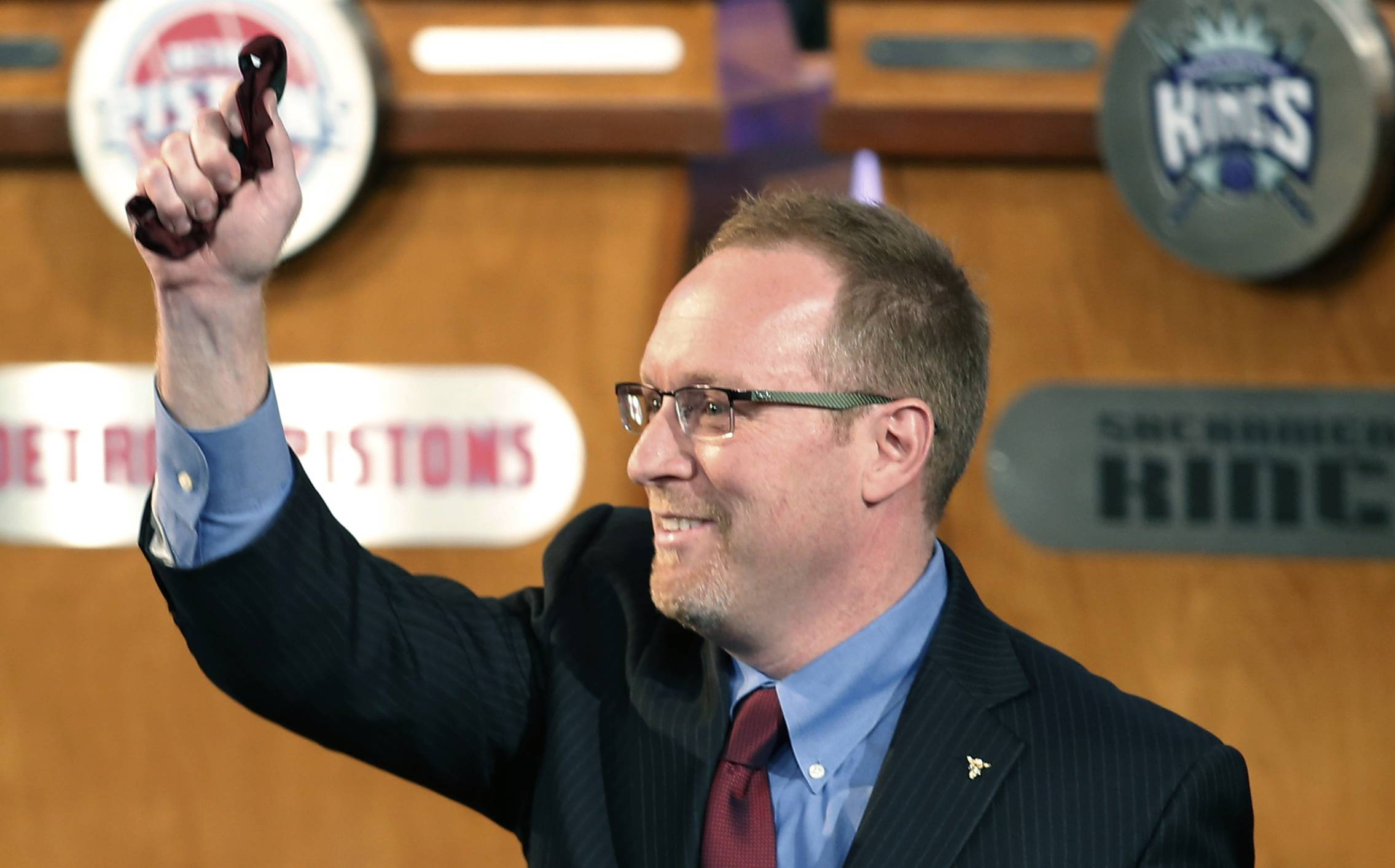 Cleveland Cavaliers general manager David Griffin holds a lucky bow tie after the Cavaliers won the first pick Tuesday in the NBA draft lottery in New York. The bowtie was worn by Nick Gilbert, son of Cavaliers owner Dan Gilbert, who represented the Cavs in the previous draft lottery, when they also won the first pick. It's the third time in four years the Cavs will be atop the draft after moving up from the ninth spot.