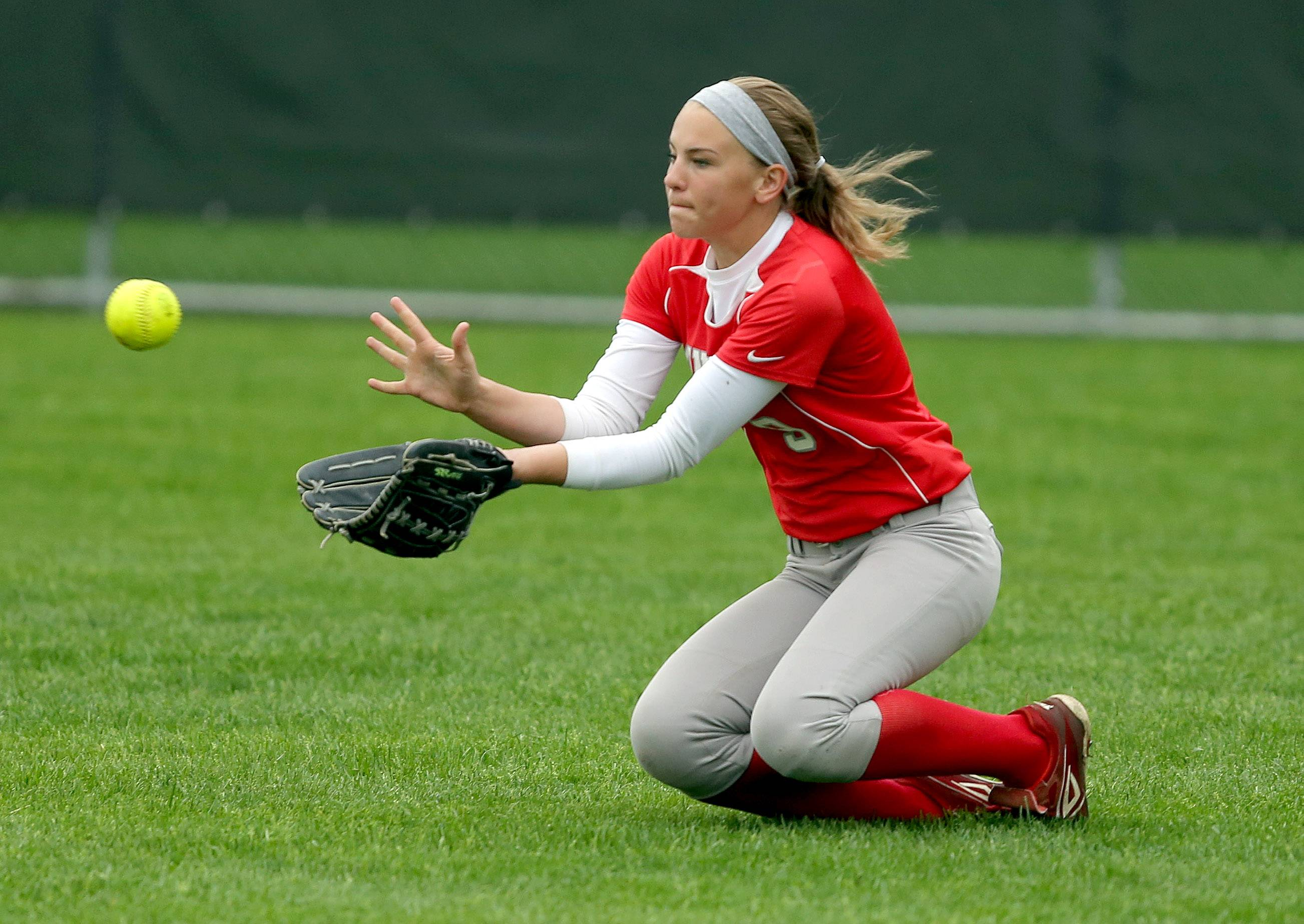 Mundelein's Karlee Busscher makes a diving catch in center field during their game against Libertyville Tuesday at Libertyville High School.