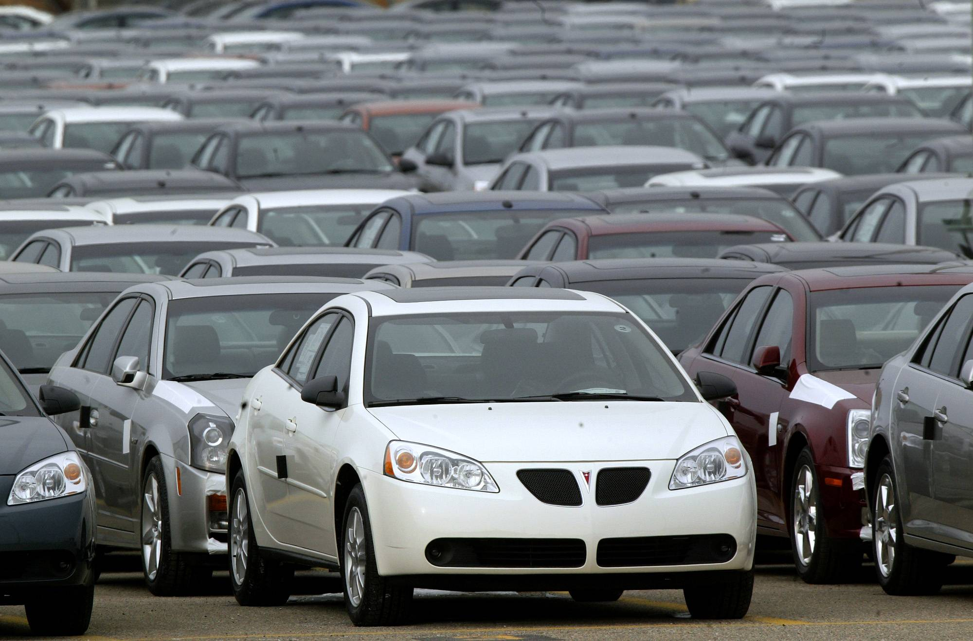 A Pontiac G6 is seen outside the General Motors Orion Assembly plant in Orion Township, Mich. General Motors is recalling 2.4 million vehicles in the U.S., including Pontiac G6's from the 2005-2008 model years, as part of a broader effort to resolve outstanding safety issues more quickly.