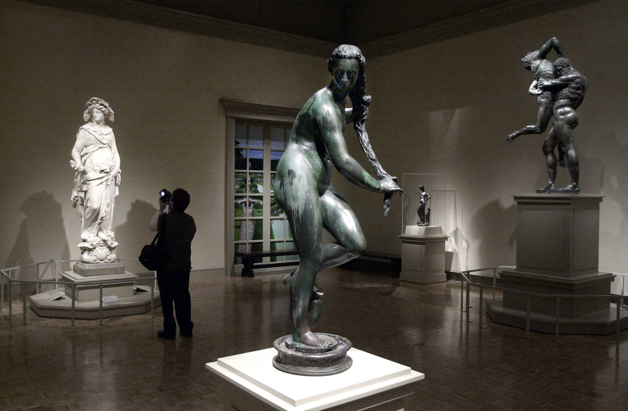 "A woman views Italian sculptures at the ""Magnificenza! The Medici, Michelangelo and The Art of Late Renaissance Florence,"" at the Detroit Institute of Arts in Detroit. Valuable art is back on the docket in Detroit's bankruptcy case"