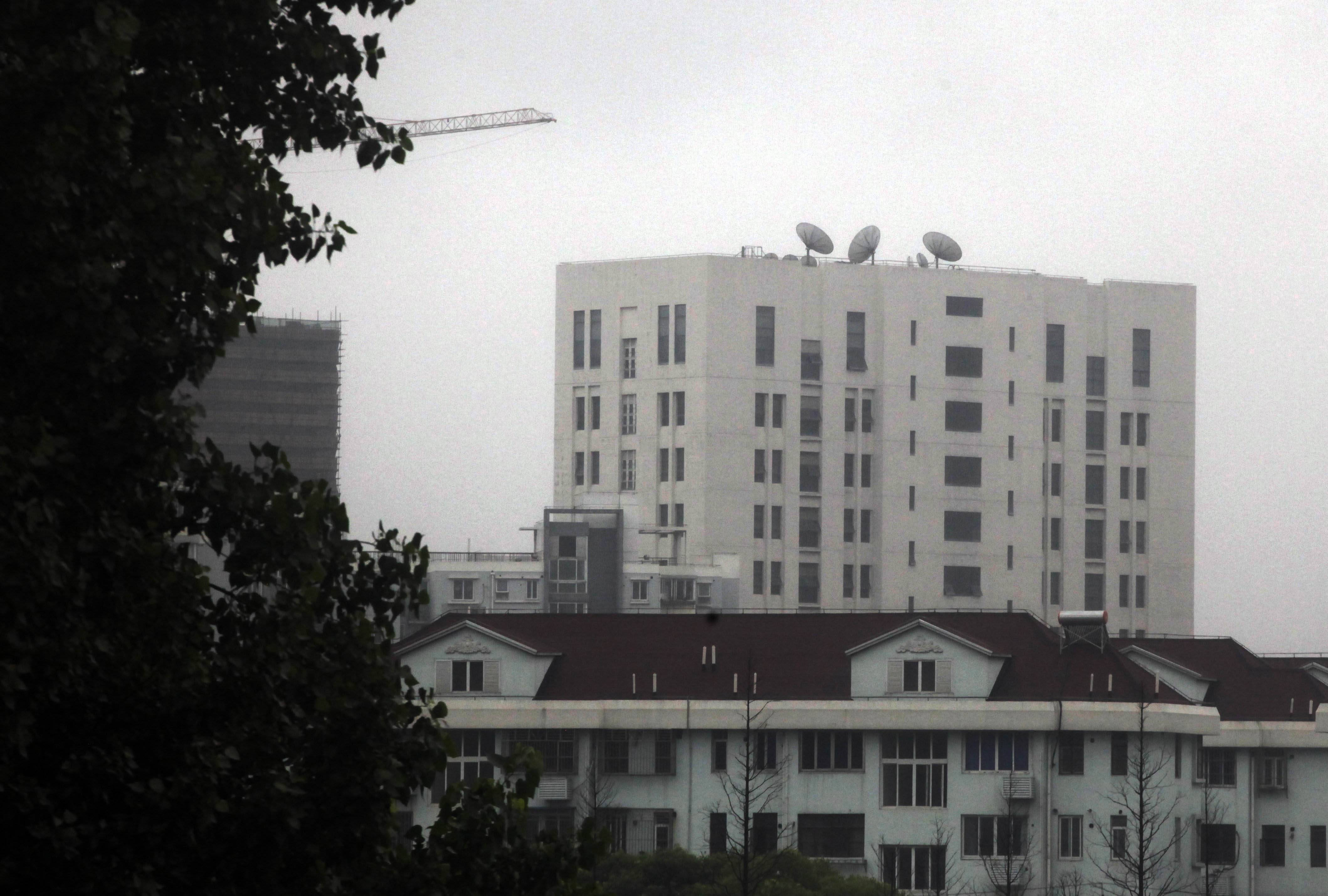 "The building housing ""Unit 61398"" of the People's Liberation Army, center top, on the outskirts of Shanghai, China. A U.S. security firm, Mandiant, said last year it traced attacks on American and other companies to the military unit in Shanghai."