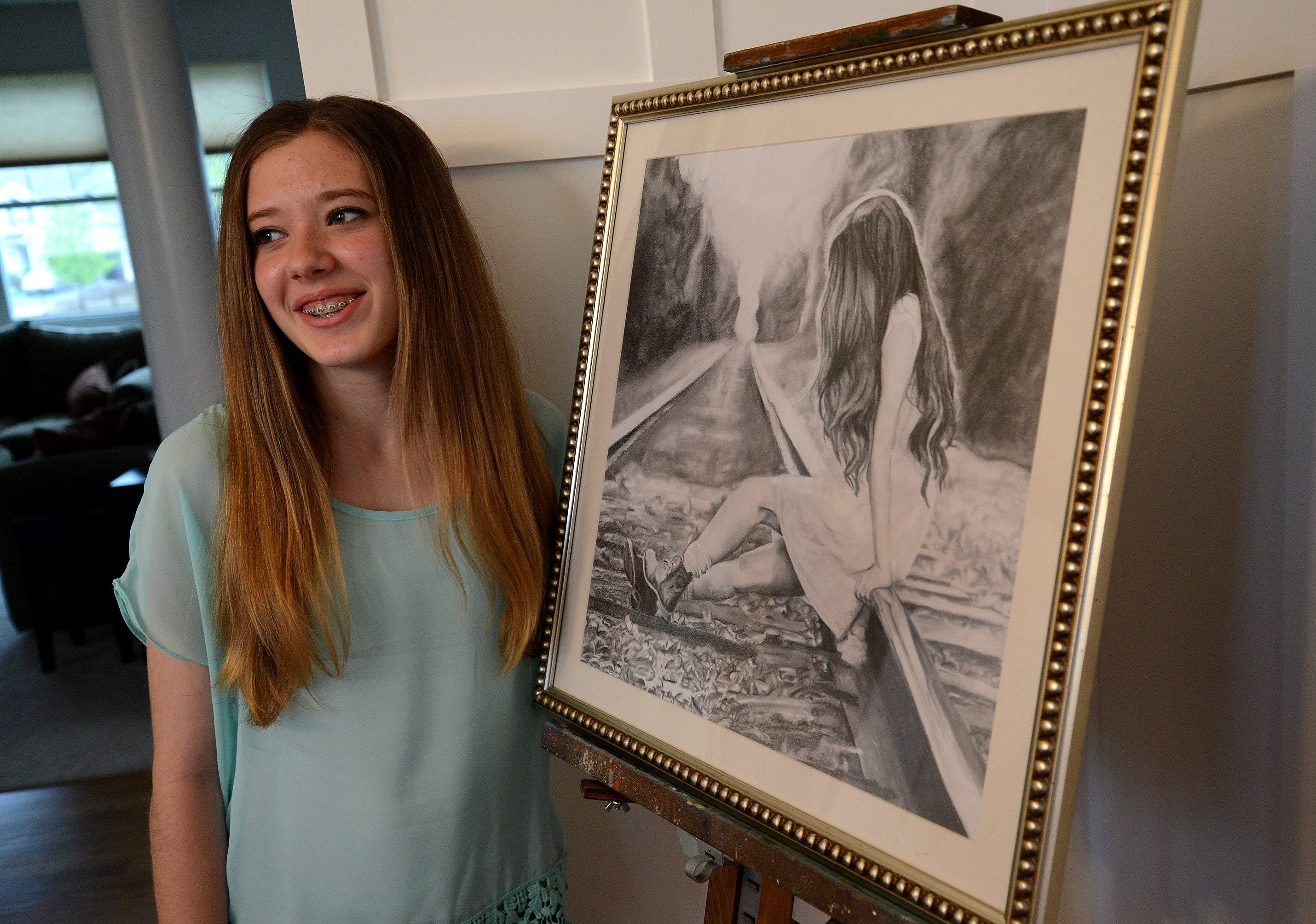"Millburn Middle School eighth-grader Sydney Janda with ""Questions,"" one of her favorite works. The pencil drawing took the top three prizes at the Antioch Women's Art League show."
