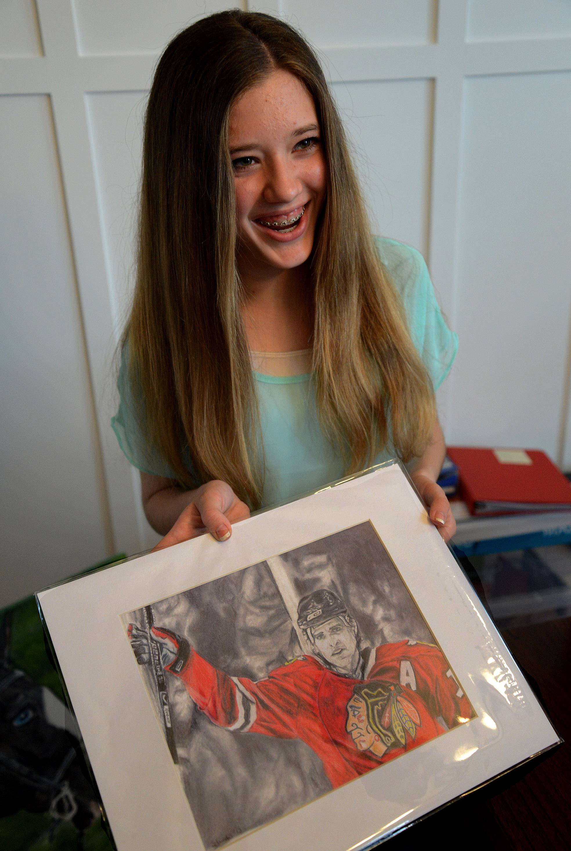 Sydney Janda with one of her Blackhawks prints, this one of Patrick Sharp.