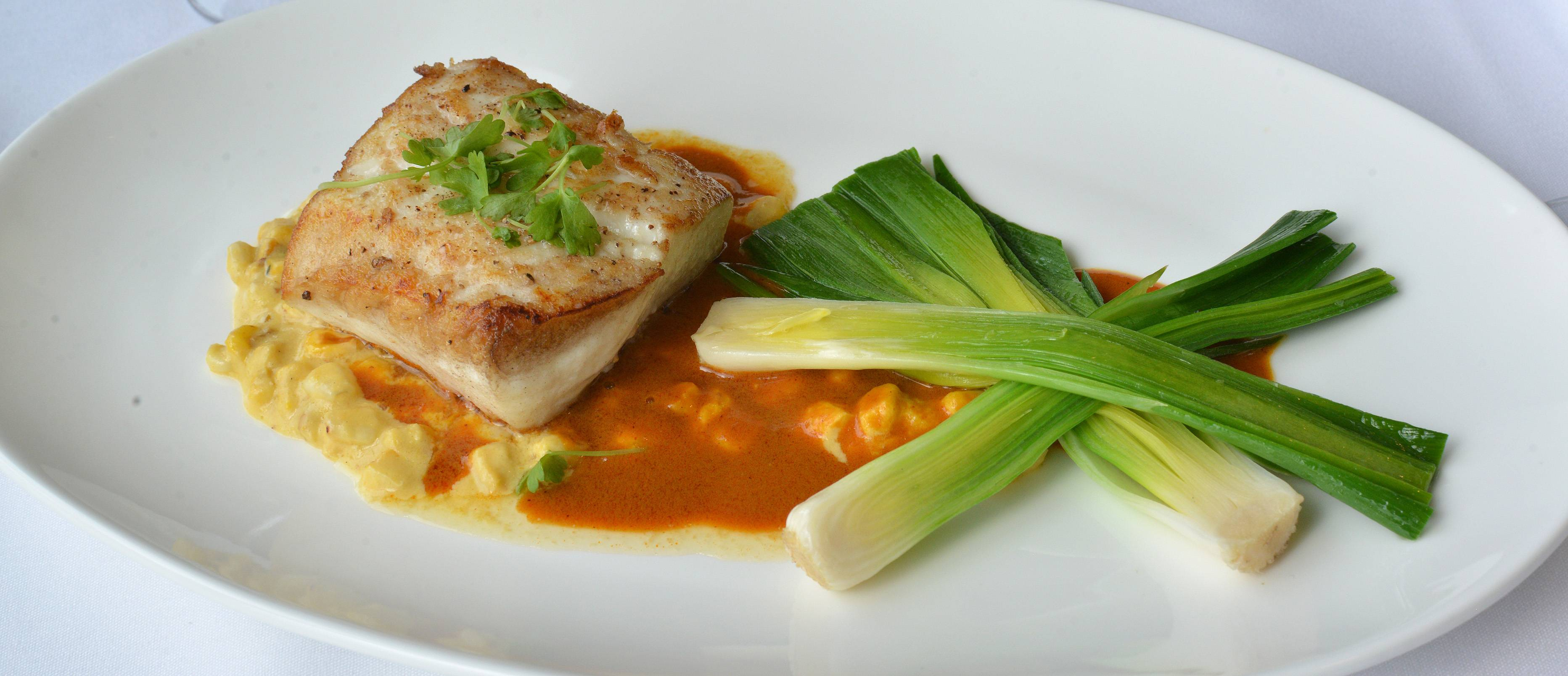 Halibut with chorizo sauce, corn chowder and braised baby leeks is a standout on Waterleaf's menu.