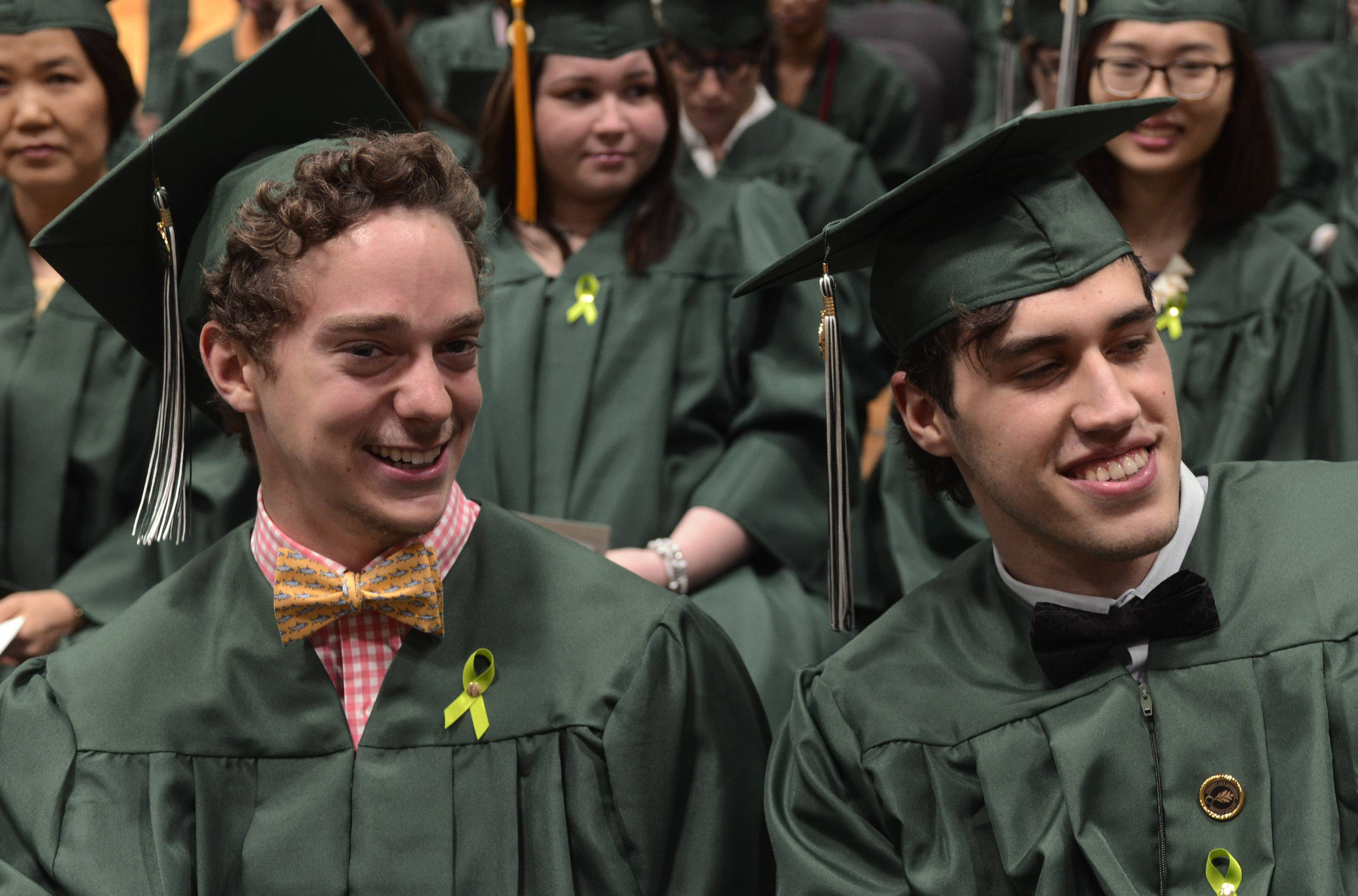 Kevin Beyer of Des Plaines, left, and Emil Vulic of Skokie don bow ties for their graduation ceremony Tuesday at Oakton Community College in Des Plaines.