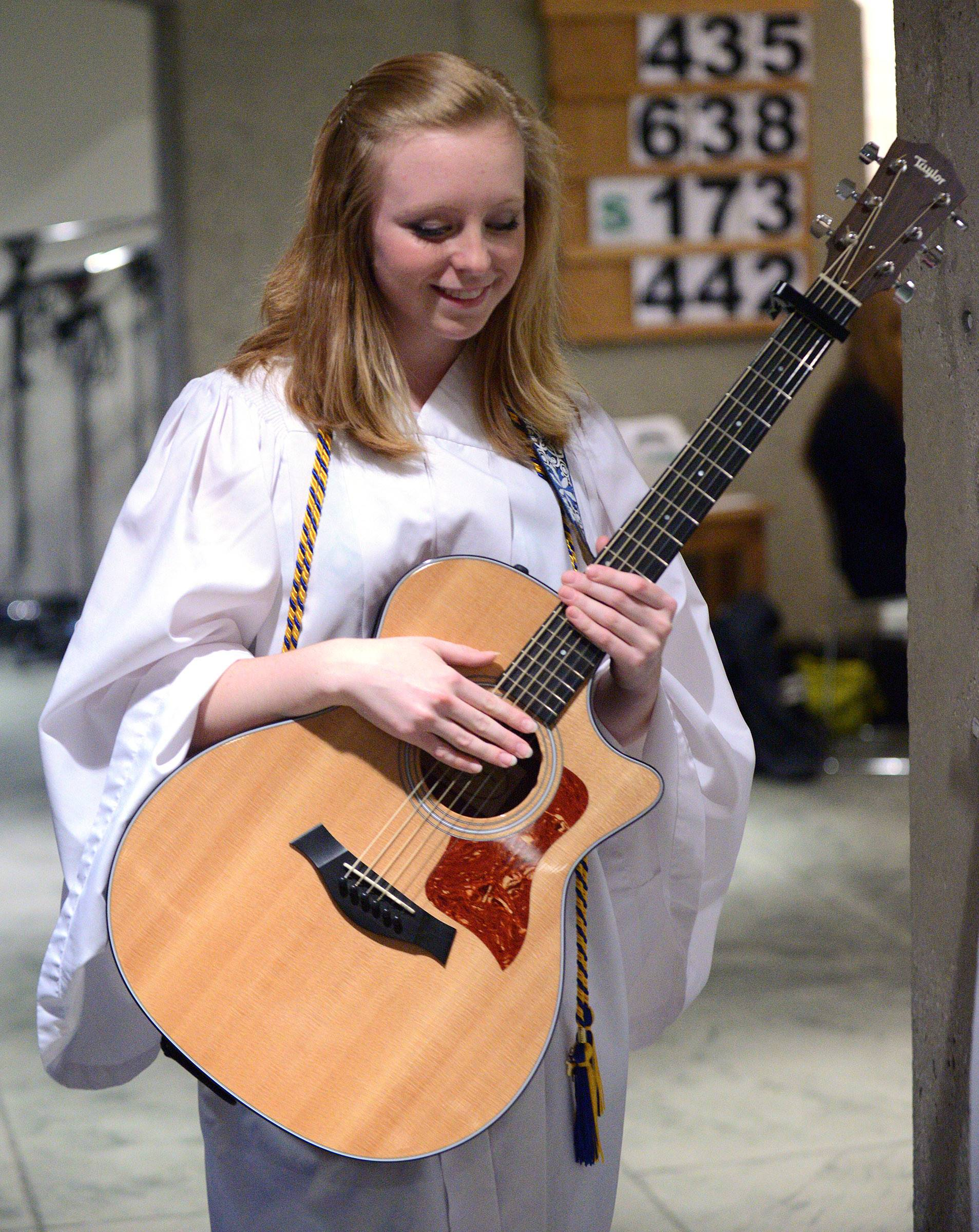 "Rosary High School graduate Emma Pettyjohn of Sugar Grove prepares to perform ""Ava Maria"" at her classmates commencement ceremony at St. John Neumann Catholic  Church in St. Charles on Tuesday, May 20."