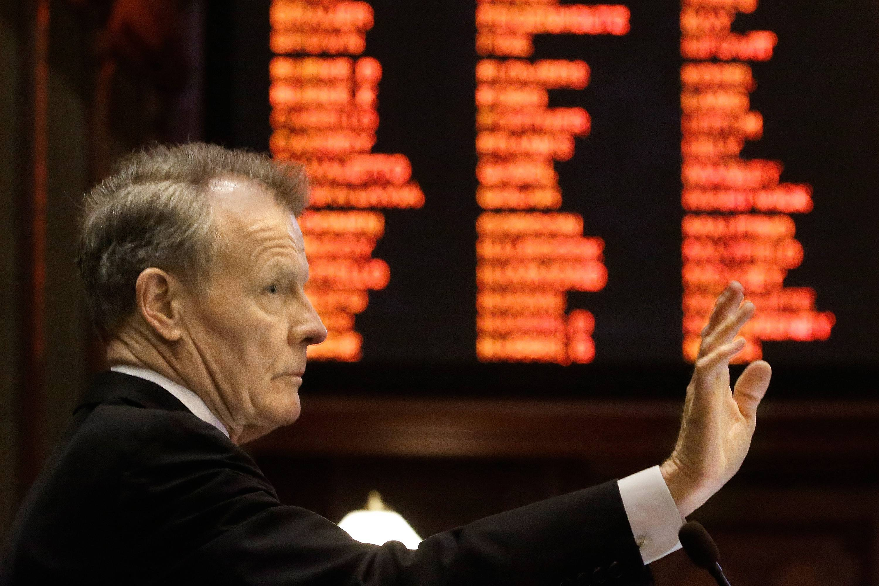 In this photo taken on Monday, llinois Speaker of the House Michael Madigan, a Chicago Democrat, speaks to lawmakers while on the House floor during session at the Illinois State Capitol in Springfield, Ill. The Illinoise House has voted in favor of putting an advisory referendum question on the ballot on raising the minimum wage.