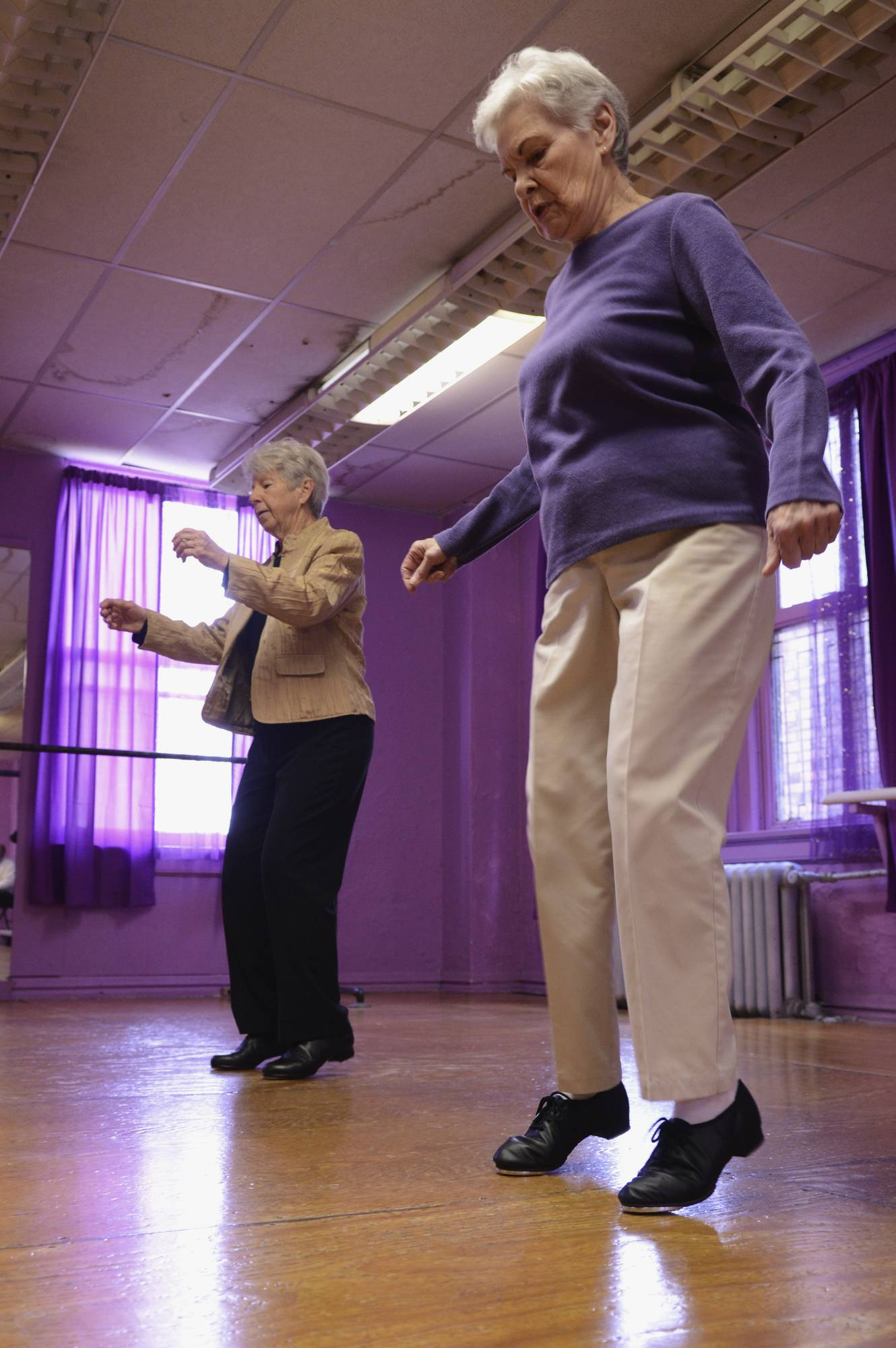 Ruth Harter, 89, right, and Betty Berneking, 79, of Davenport, Iowa, practice their tap-dancing routine at Kim's School of Dance & Tumbling in Moline.