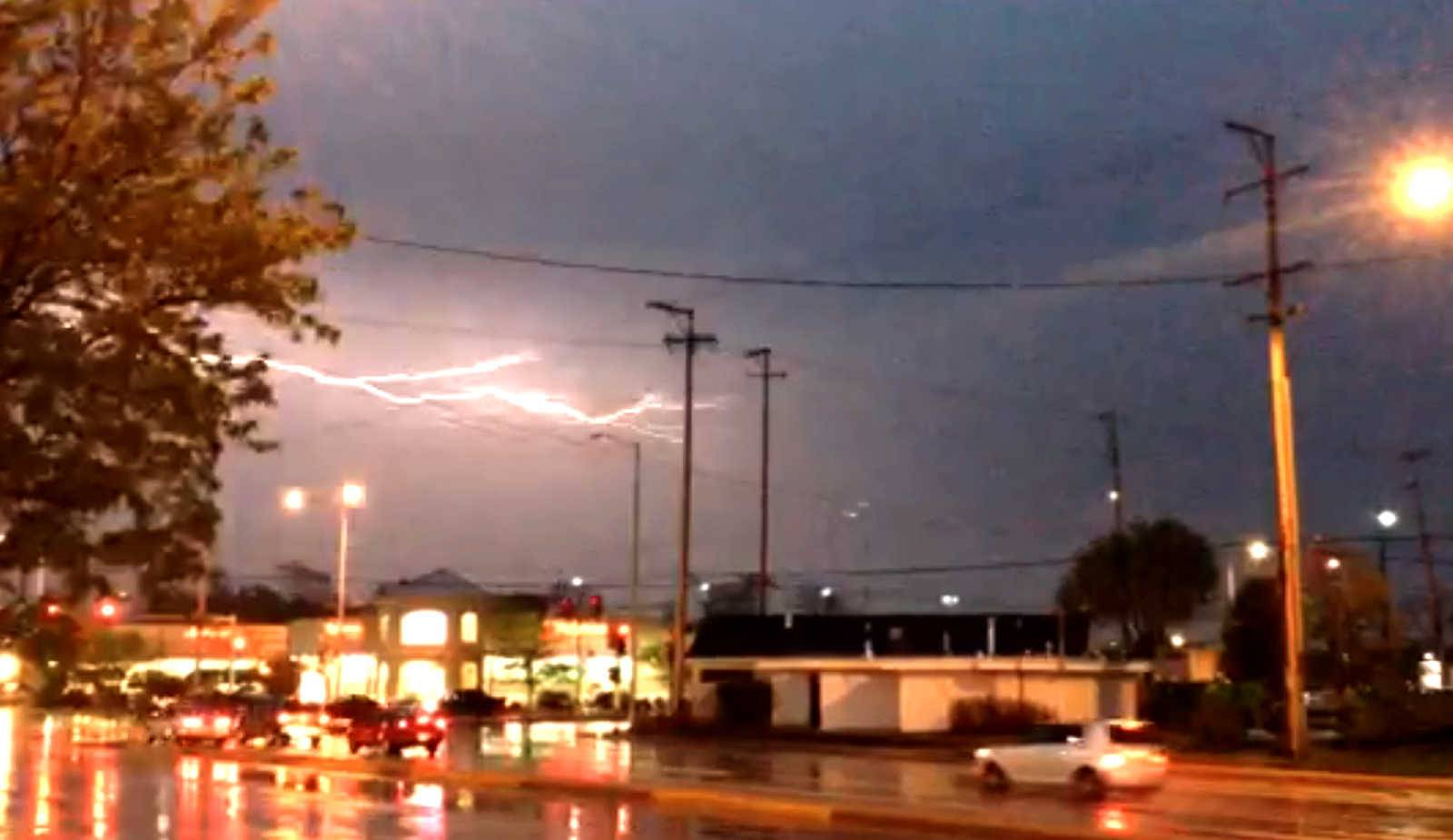 Lightning flashes along Golf Road at Arlington Heights Road on Tuesday evening.