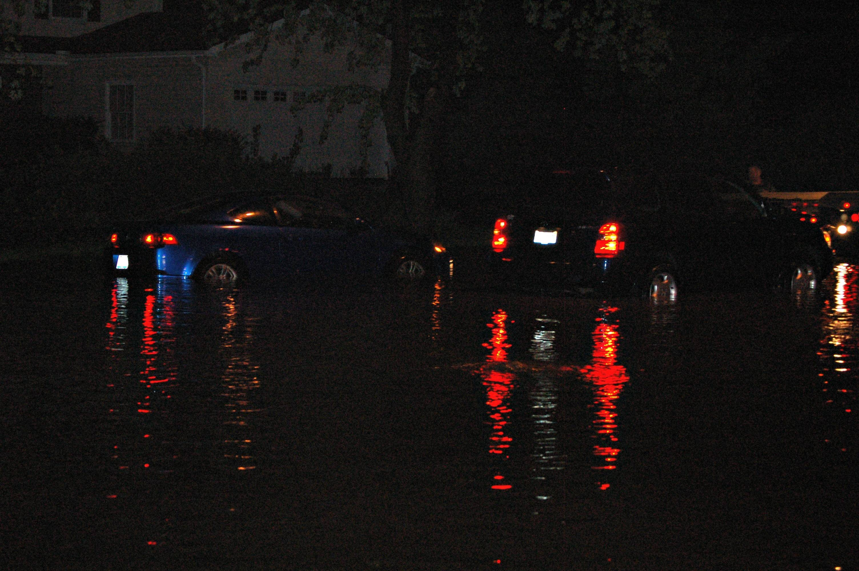 Cars were deep in water on Oleson Drive in Naperville after a deluge of rain and hail hit DuPage County suburbs Tuesday. Nearby resident Maggie Newlin said she had to park her car and walk home.