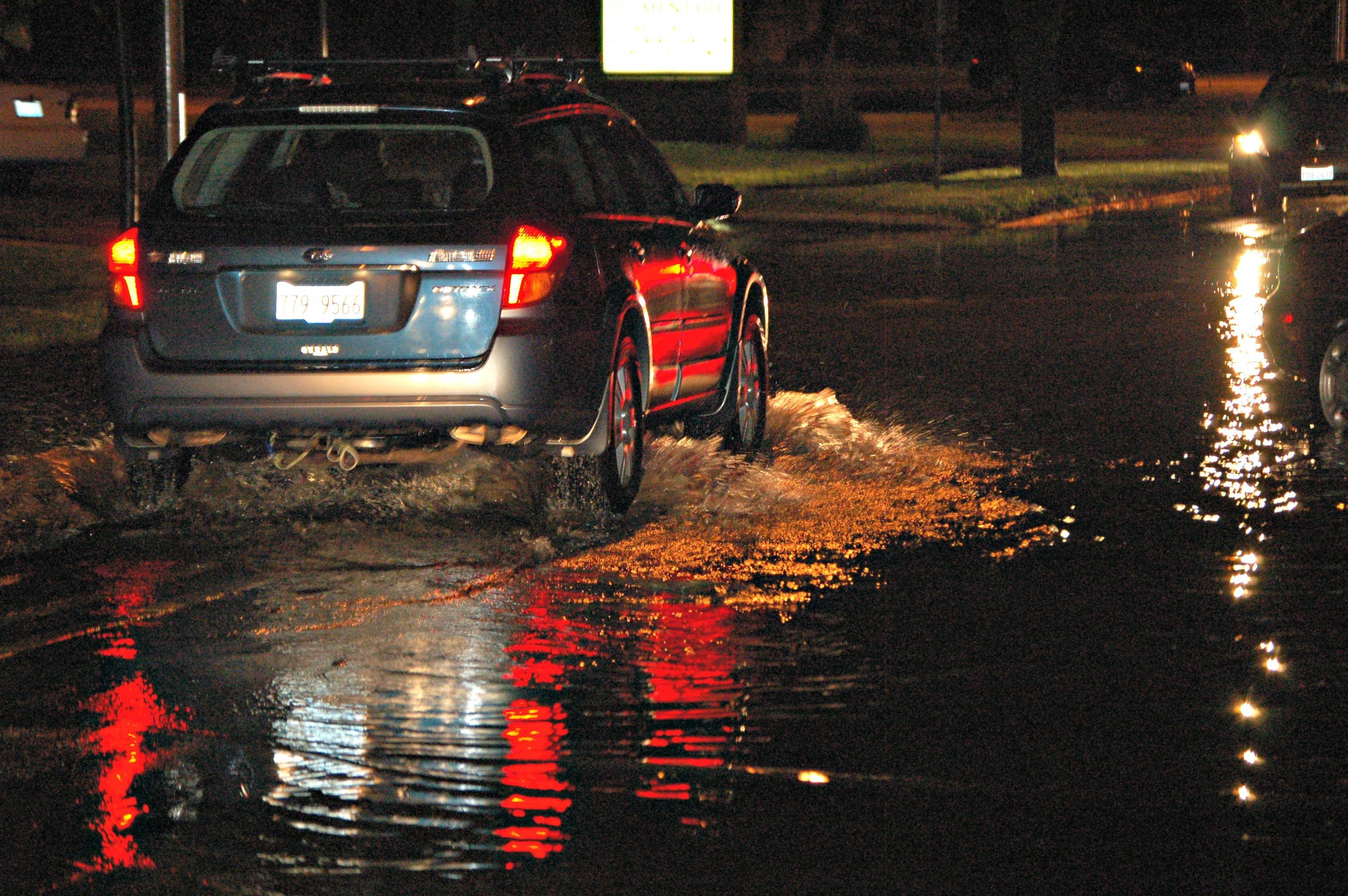 Cars struggled through Oleson Drive in Naperville after a deluge of rain and hail hit DuPage County suburbs Tuesday.