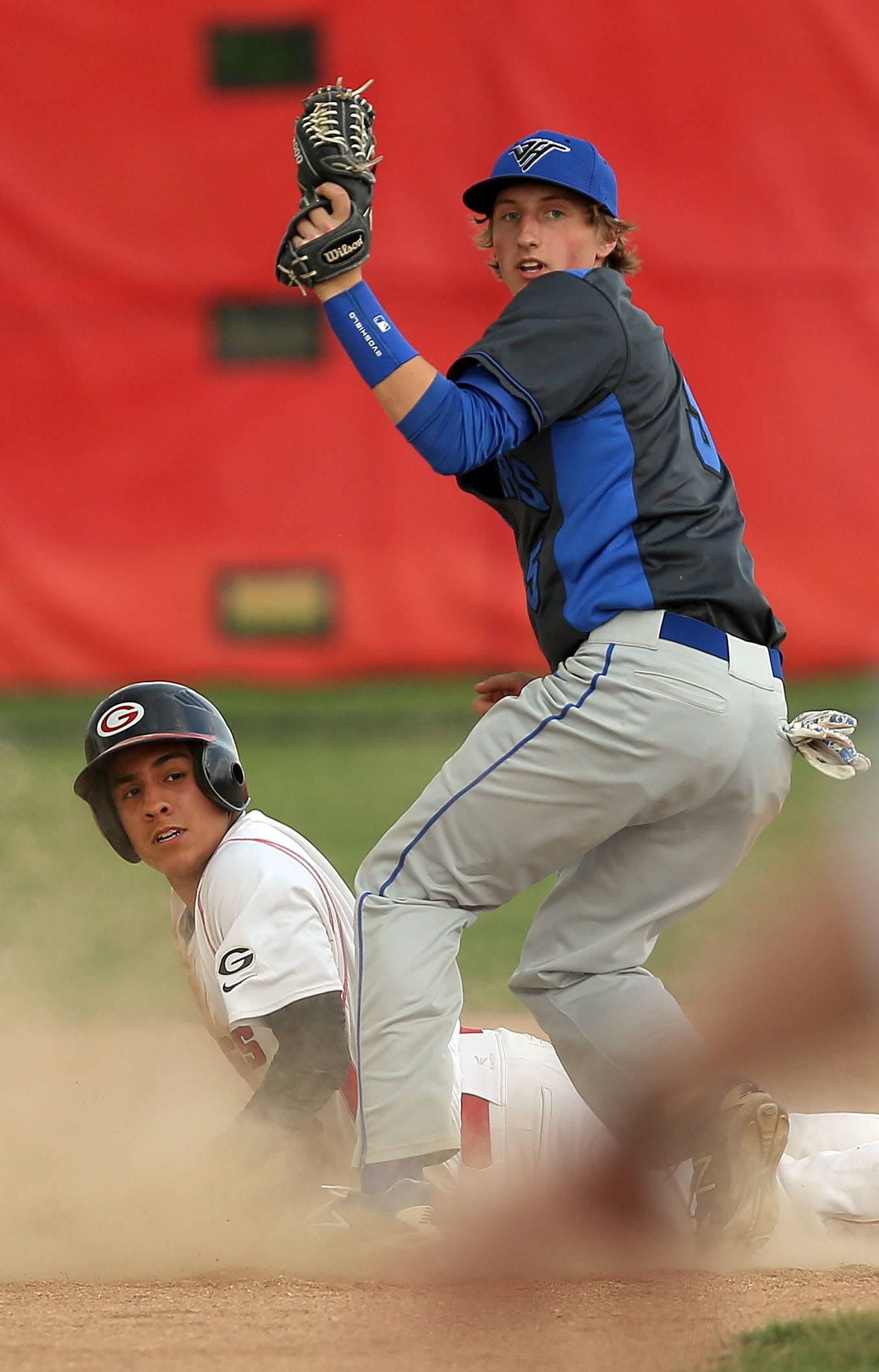 Grant's Peter Perales, left, slides safely into second as Vernon Hills' Jake Boyer looks for the call Tuesday at Grant.