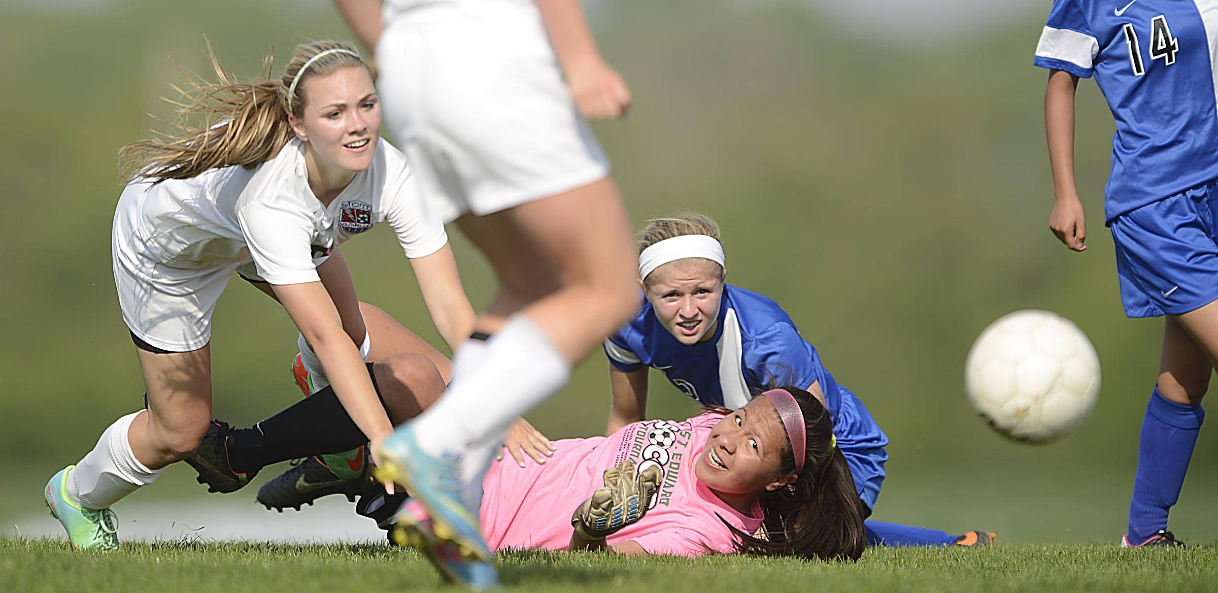 South Elgin's Caitlin Lange falls as she watches her shot get past Larkin goalkeeper Alejandra Villagomez and Jaci Bridgers for a goal in the first half Tuesday in South Elgin.