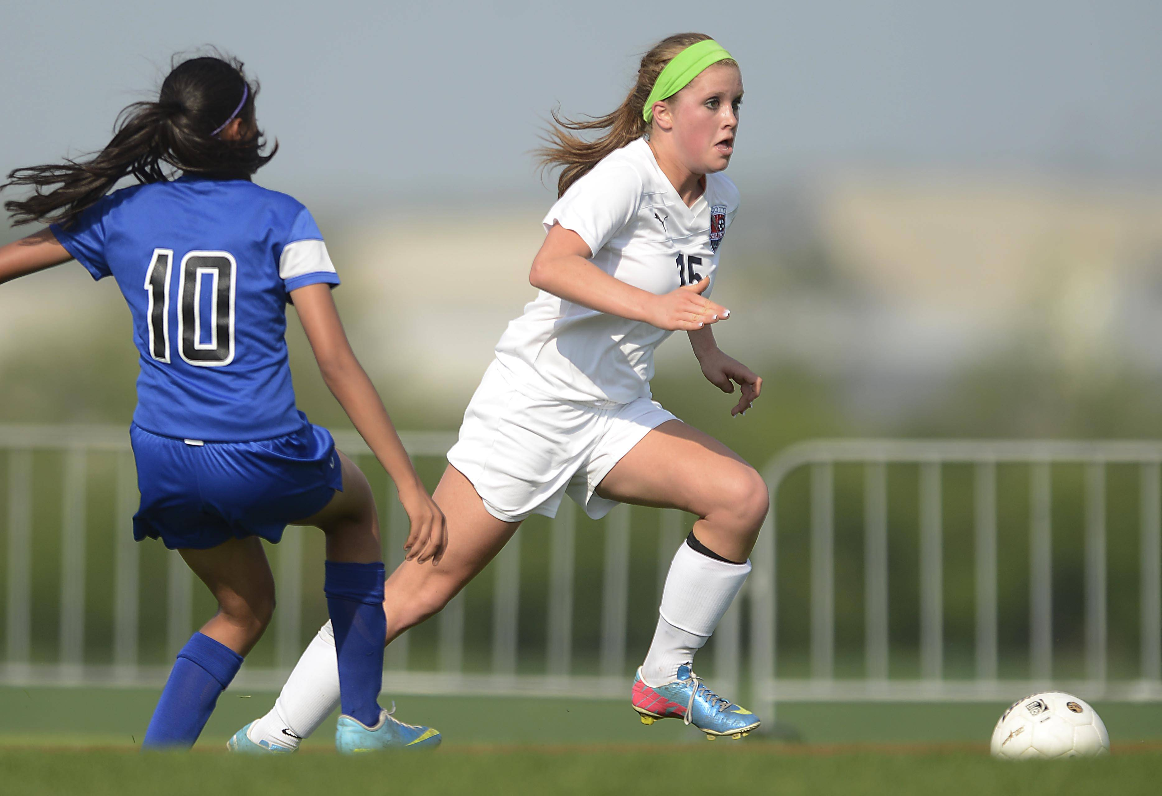 South Elgin's Anna Tracy gets around Larkin's Maria Mendoza Tuesday in South Elgin. Tracy scored twice in the first half.