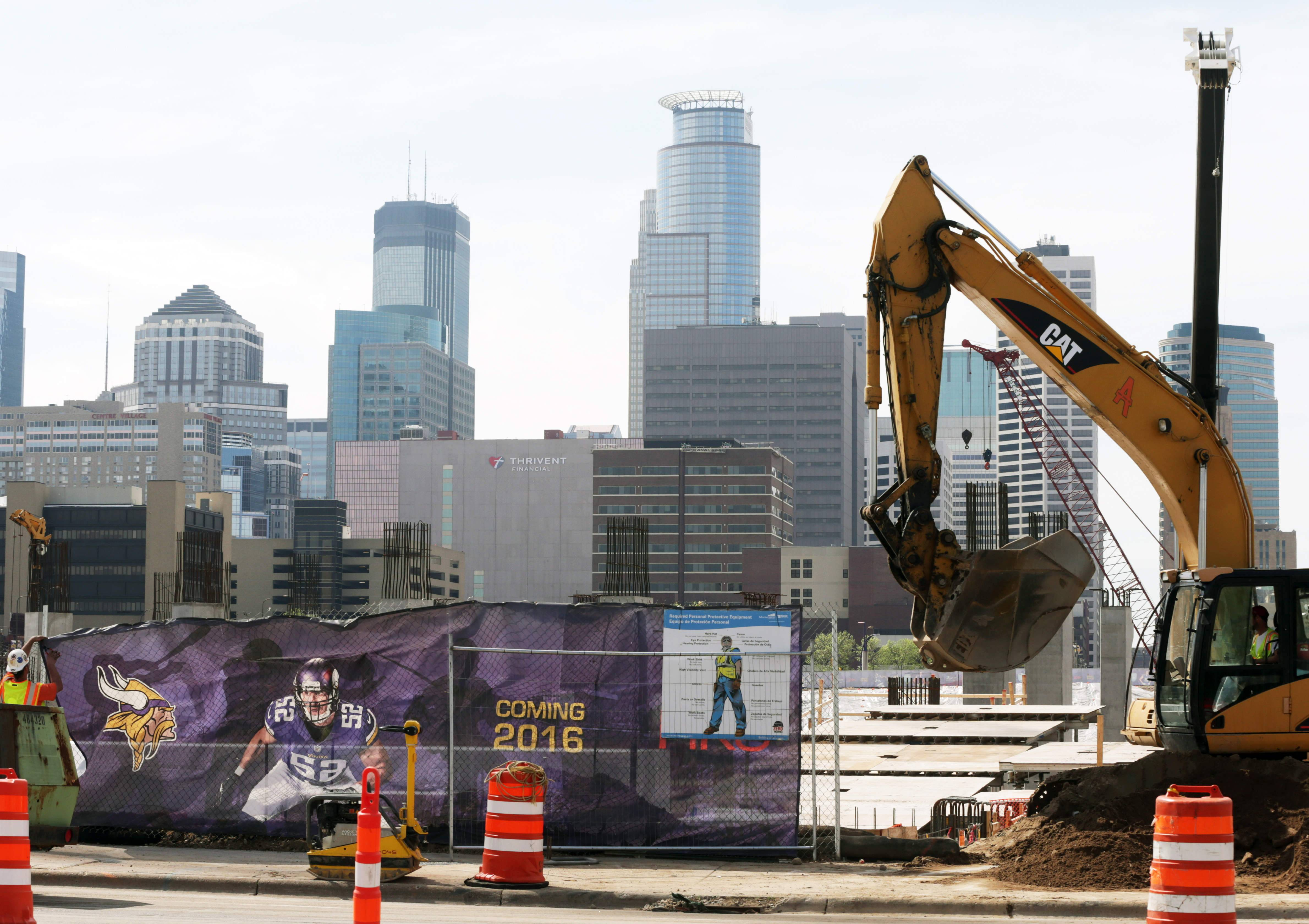 The Minneapolis skyline rises in the background as work continues Tuesday on the new Minnesota Vikings NFL football stadium in Minneapolis. Minneapolis will host the 2018 Super Bowl after a vote by owners Tuesday rewarded the city for its new stadium deal
