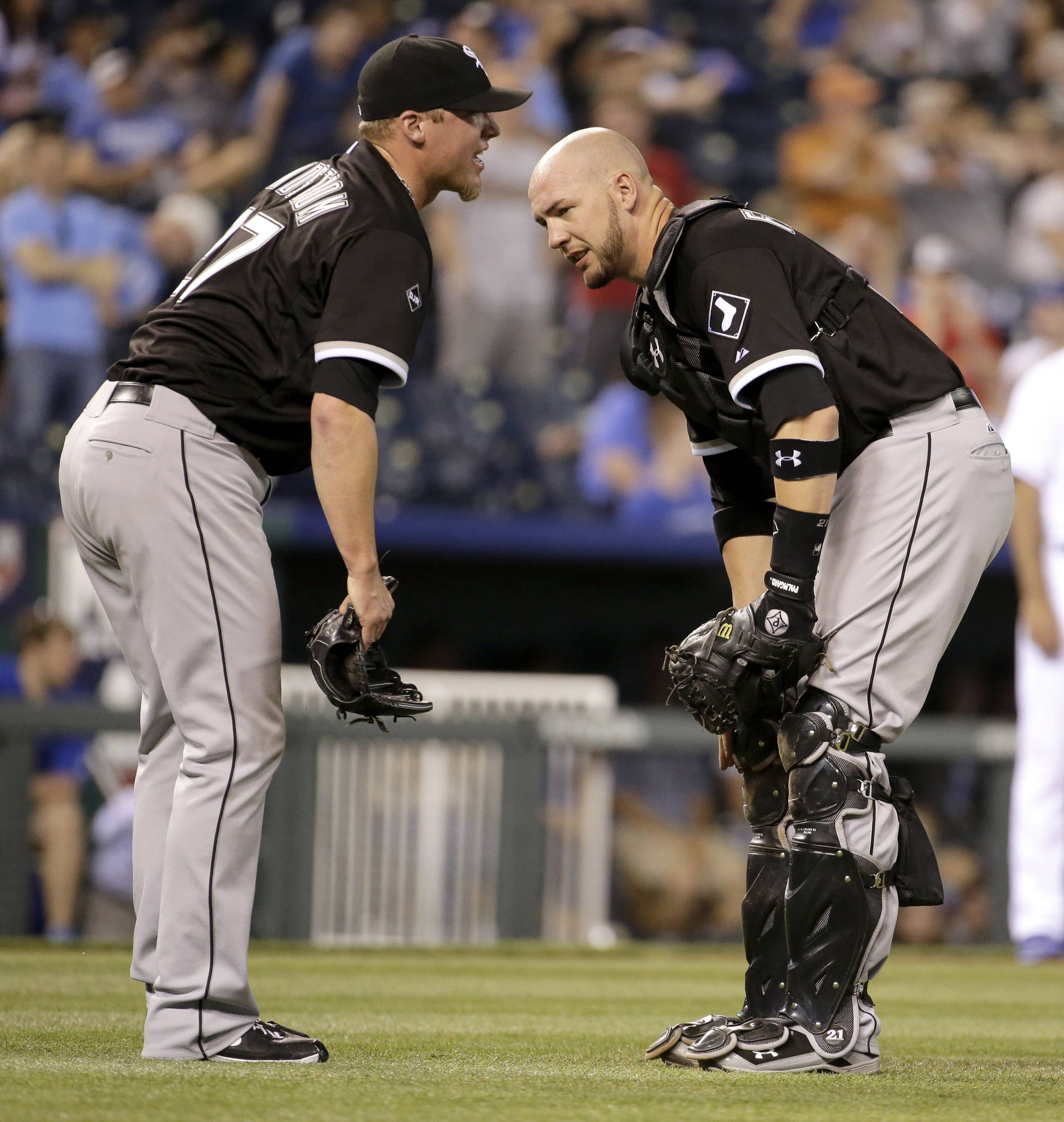 Chicago White Sox relief pitcher Matt Lindstrom, left, reacts  after getting injured during the ninth inning Monday against the Kansas City Royals. The Sox have placed Lindstrom on the 15-day disabled list.