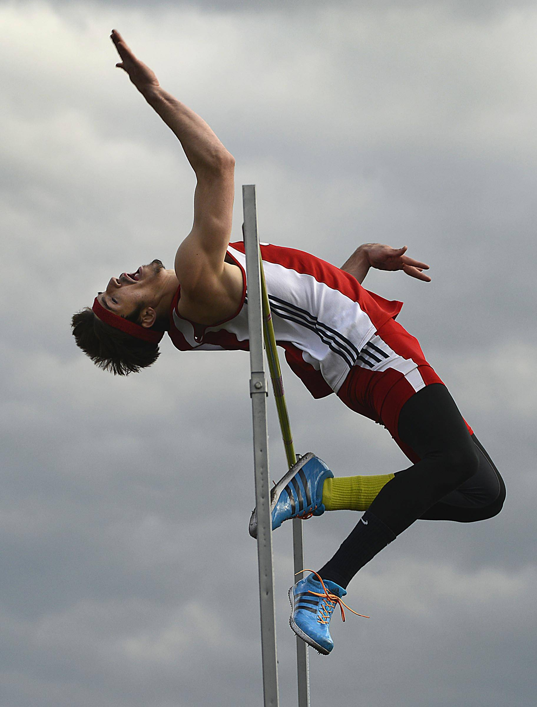 South Elgin's Kyle Kumerow flies over the high jump bar Thursday at the Upstate Eight Conference boys track meet at Memorial Field at Elgin High School.