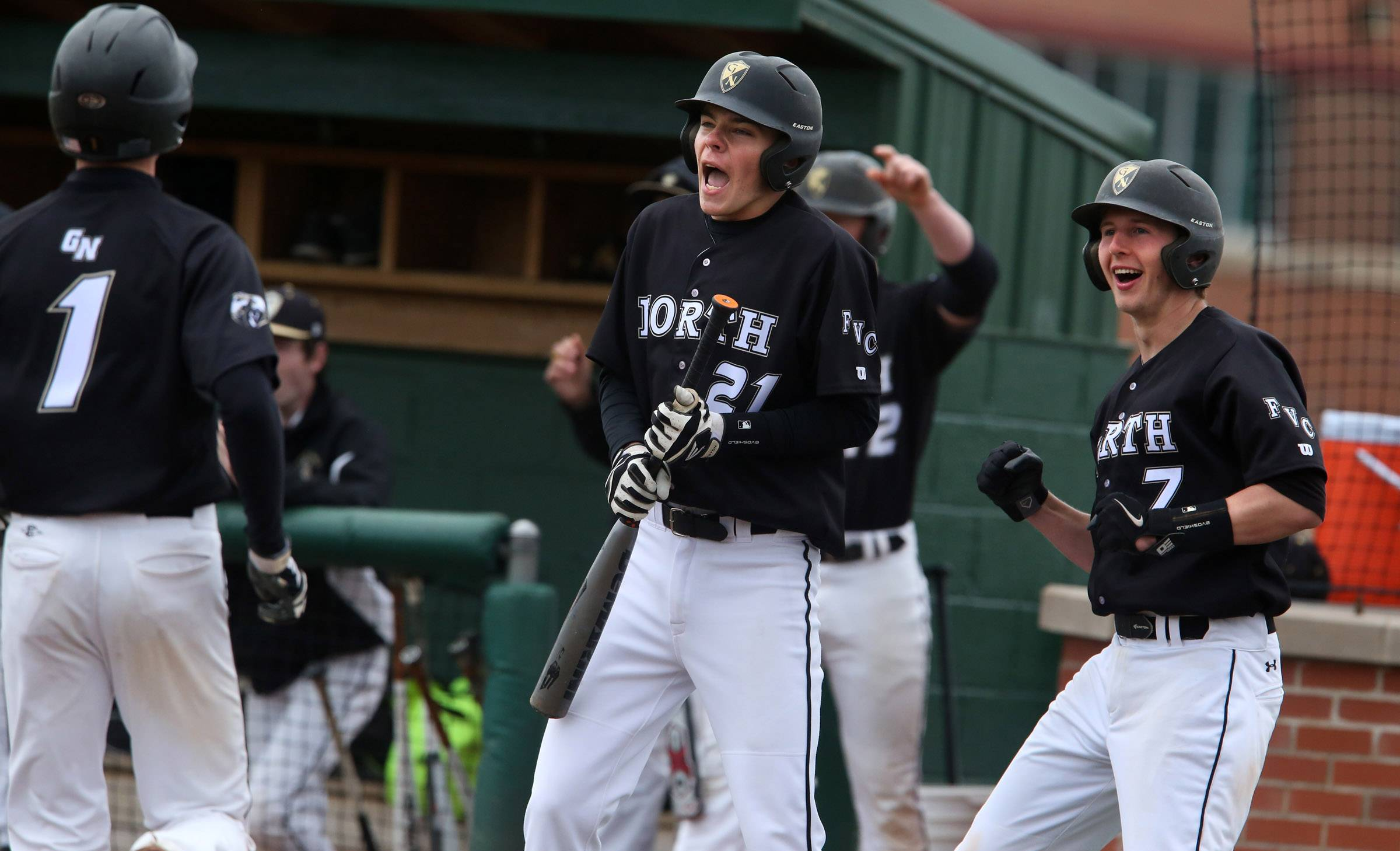 Grayslake North's Ryan Gross, center, and Jason Petrillo, right, celebrate as Sam Cremin, left, crosses the plate against Grayslake Central on Friday at Grayslake Central.