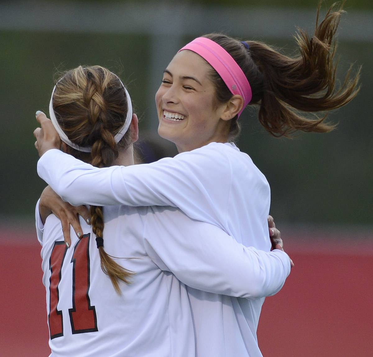 Barrington's Jenna Szczesny, left, is congratulated for her first-half goal by teammate Nicole Niro during the Mid Suburban League championship game at Barrington Wednesday.