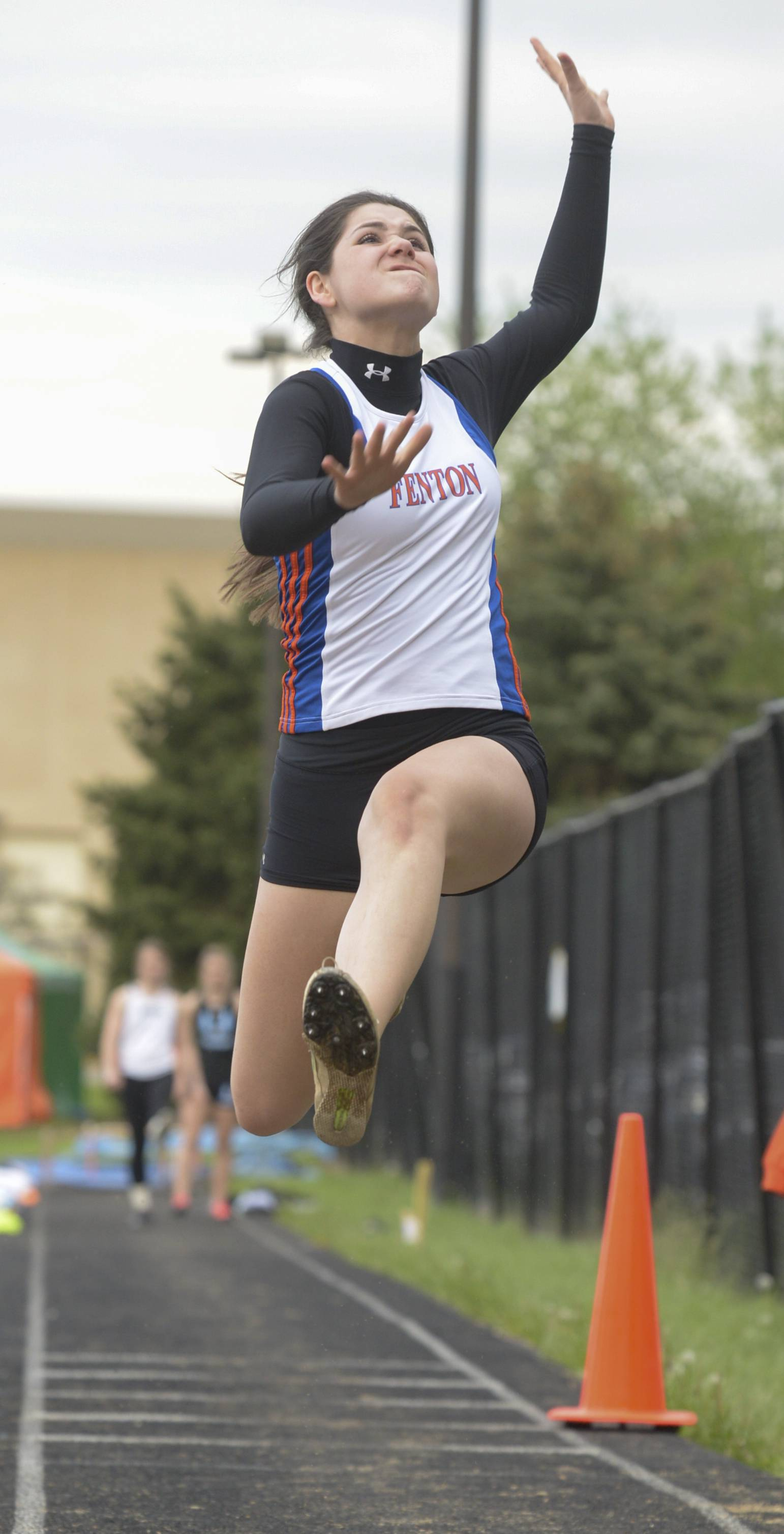 Kayla Kottra of Fenton competes in the triple jump during the Wheaton Warrenville South girls track sectional.
