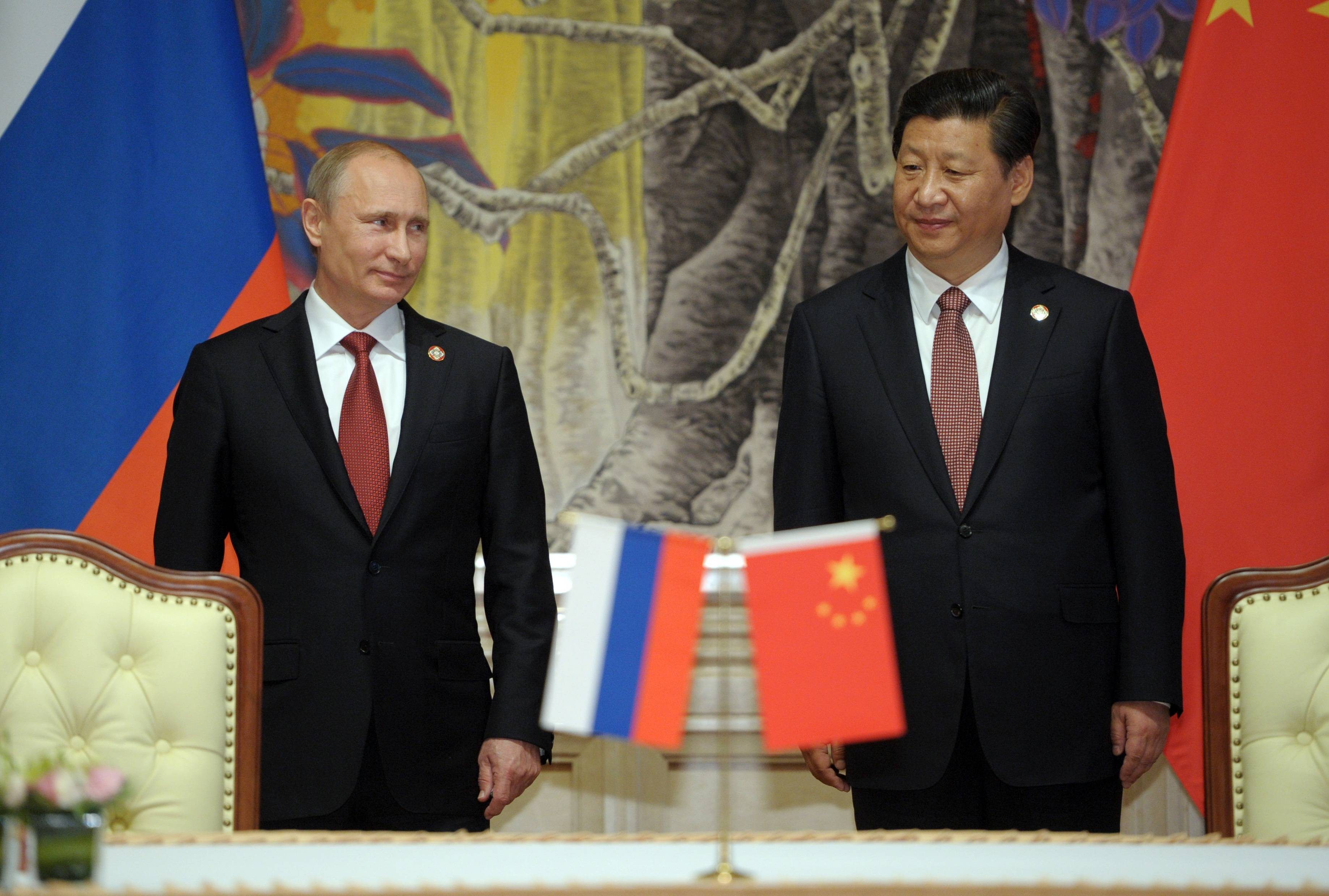 Russia's President Vladimir Putin, and China's President Xi Jinping, right, appear at a signing ceremony in Shanghai, China, Wednesday. China signed a long-awaited, 30-year deal Wednesday to buy Russian natural gas worth some $400 billion in a financial and diplomatic boost to diplomatically isolated President Vladimir Putin.