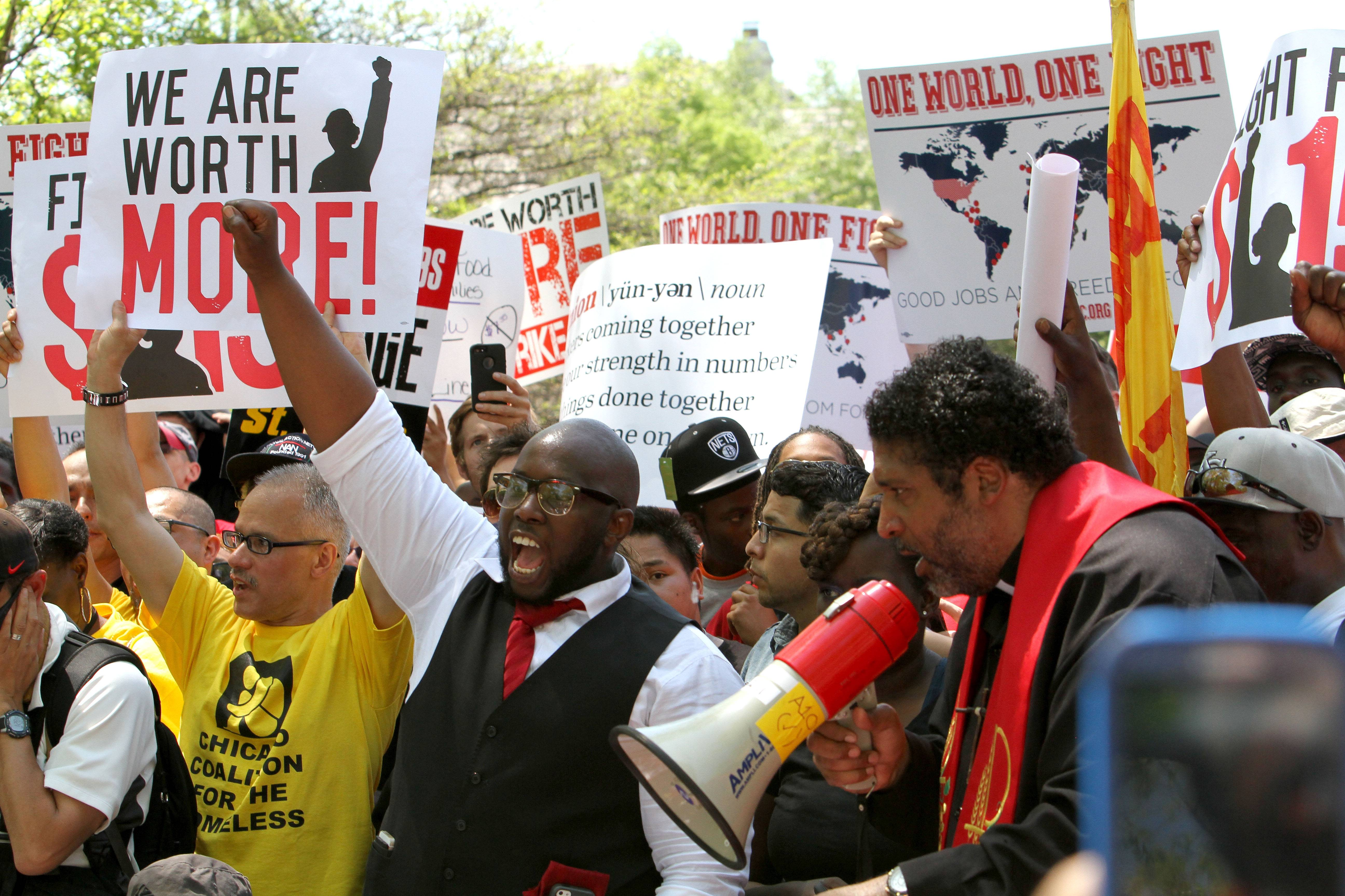 Protesters walk onto the property at McDonald's campus in Oak Brook on Wednesday to call for worker wages of $15 an hour.