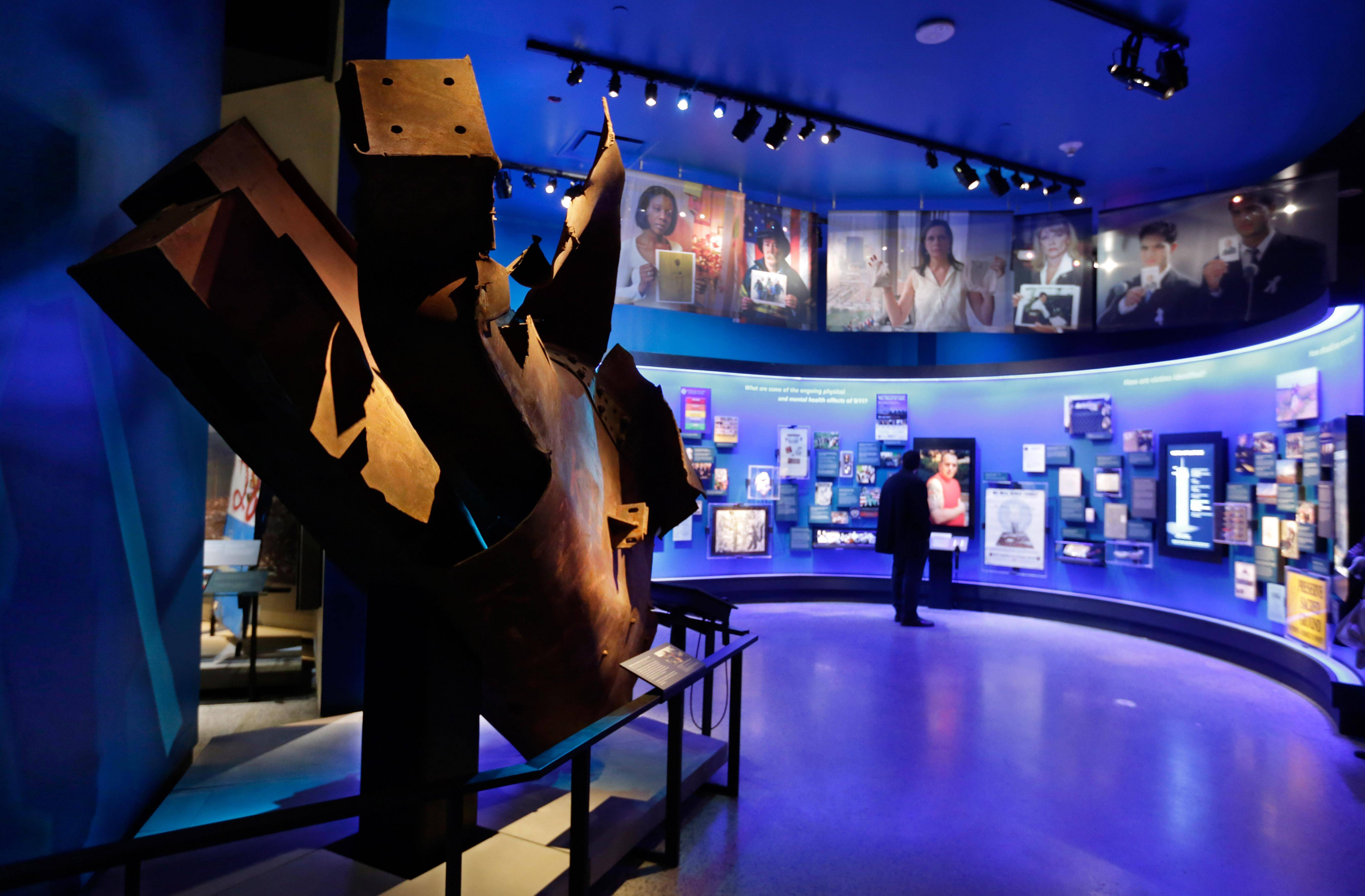 "Steel from the World Trade Center north tower floors 97 and 98, left, is displayed at the National Sept. 11 Memorial Museum in New York. The museum was designed to accurately depict the events from Sept. 11, 2001, while not making the presentation intolerable for the public. One designer who helped create the exhibits says ""there's a lot of thought given to the psychological safety of visitors."""