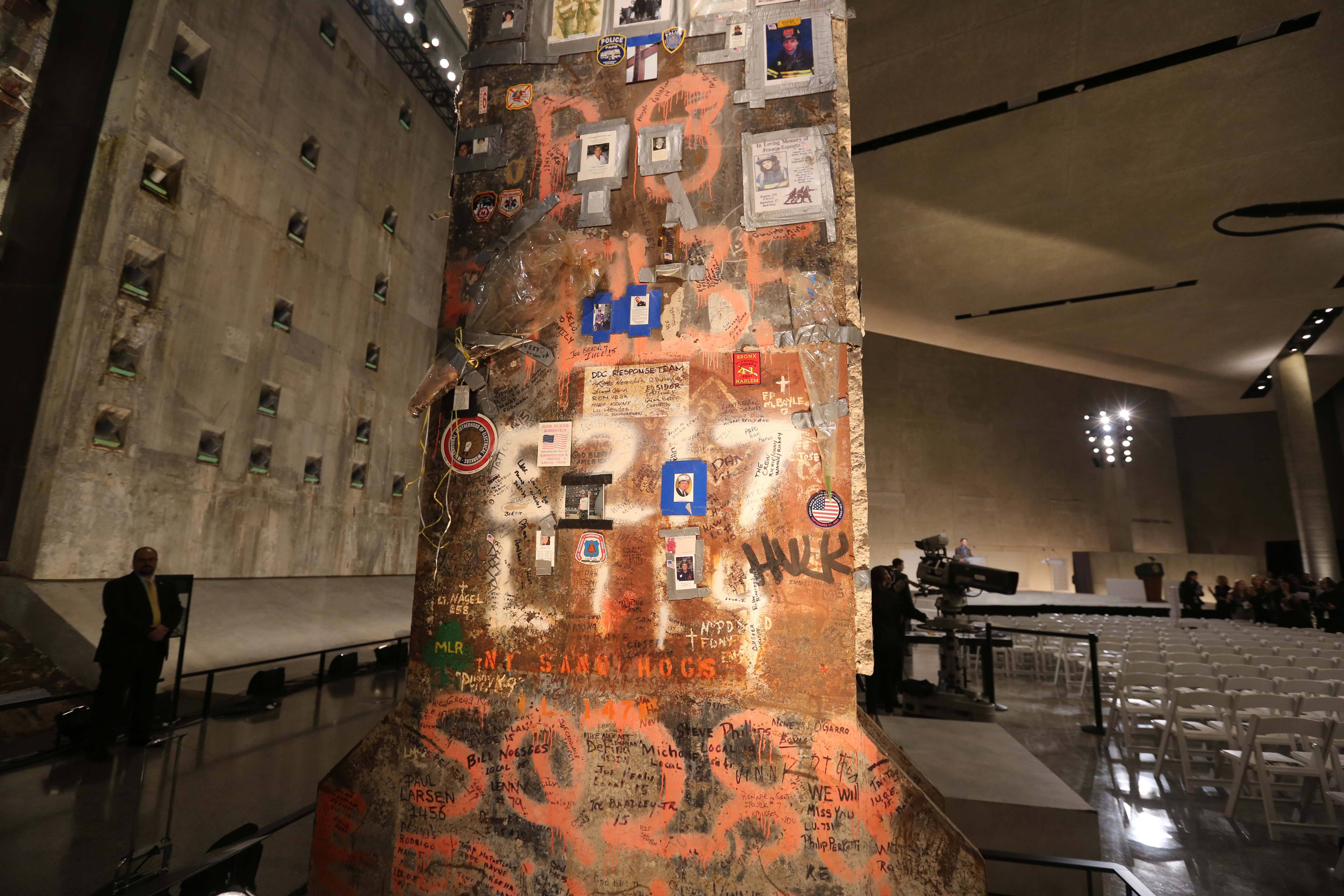 A steel beam from the World Trade Center stands at the center of Foundation Hall in the National Sept. 11 Memorial Museum in New York. Behind the wrenching sights and sounds of the museum lies a quiet effort to help visitors handle its potentially traumatic impact, from built-in tissue boxes to a layout designed to let people bypass the most intense exhibits if they choose.