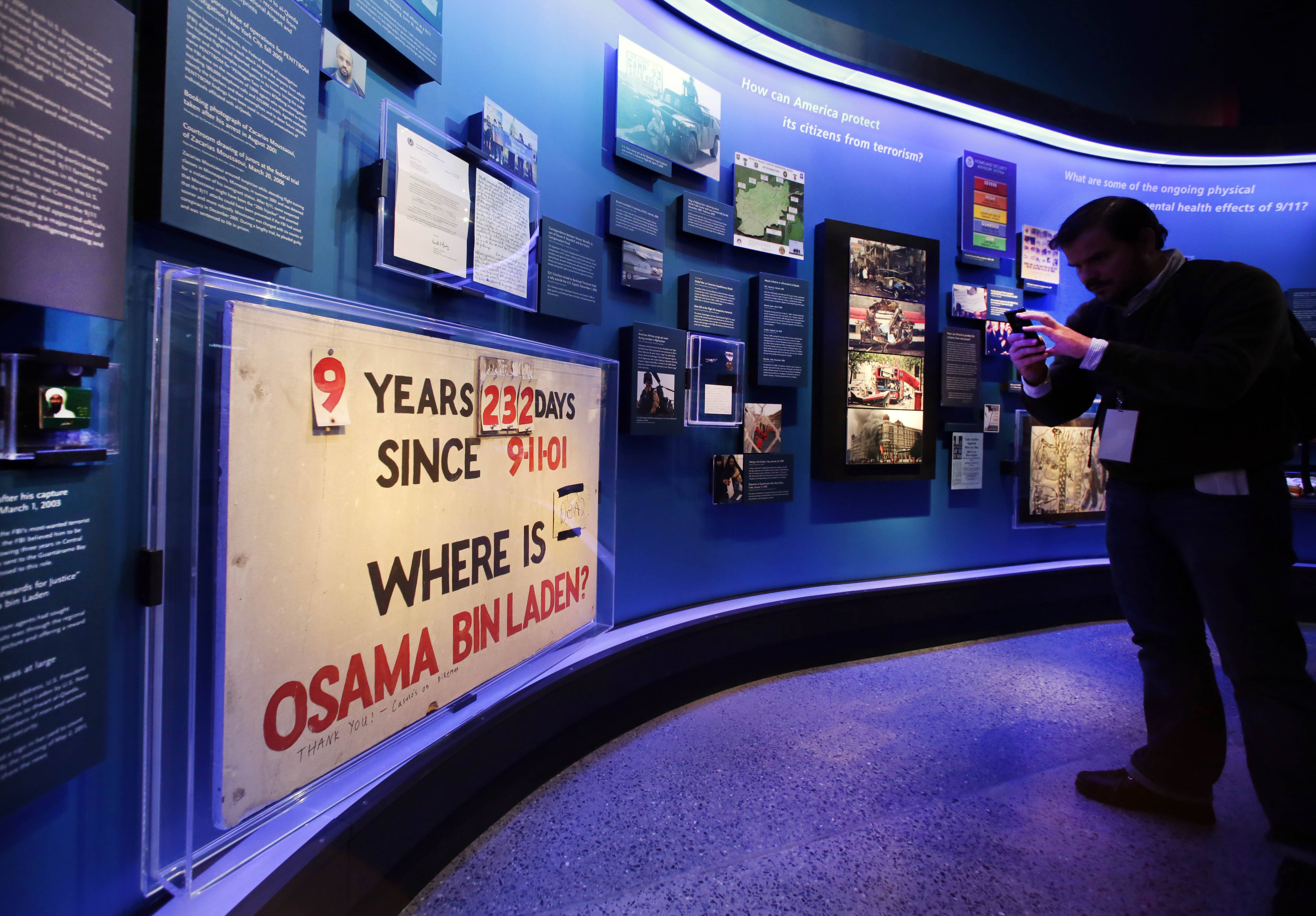A sign tracking the time Osama bin Laden was at large is displayed at the National Sept. 11 Memorial Museum in New York. The museum is the latest in a series of memorials-as-museums that seek to honor the dead while presenting a full, fair history of the event that killed them.