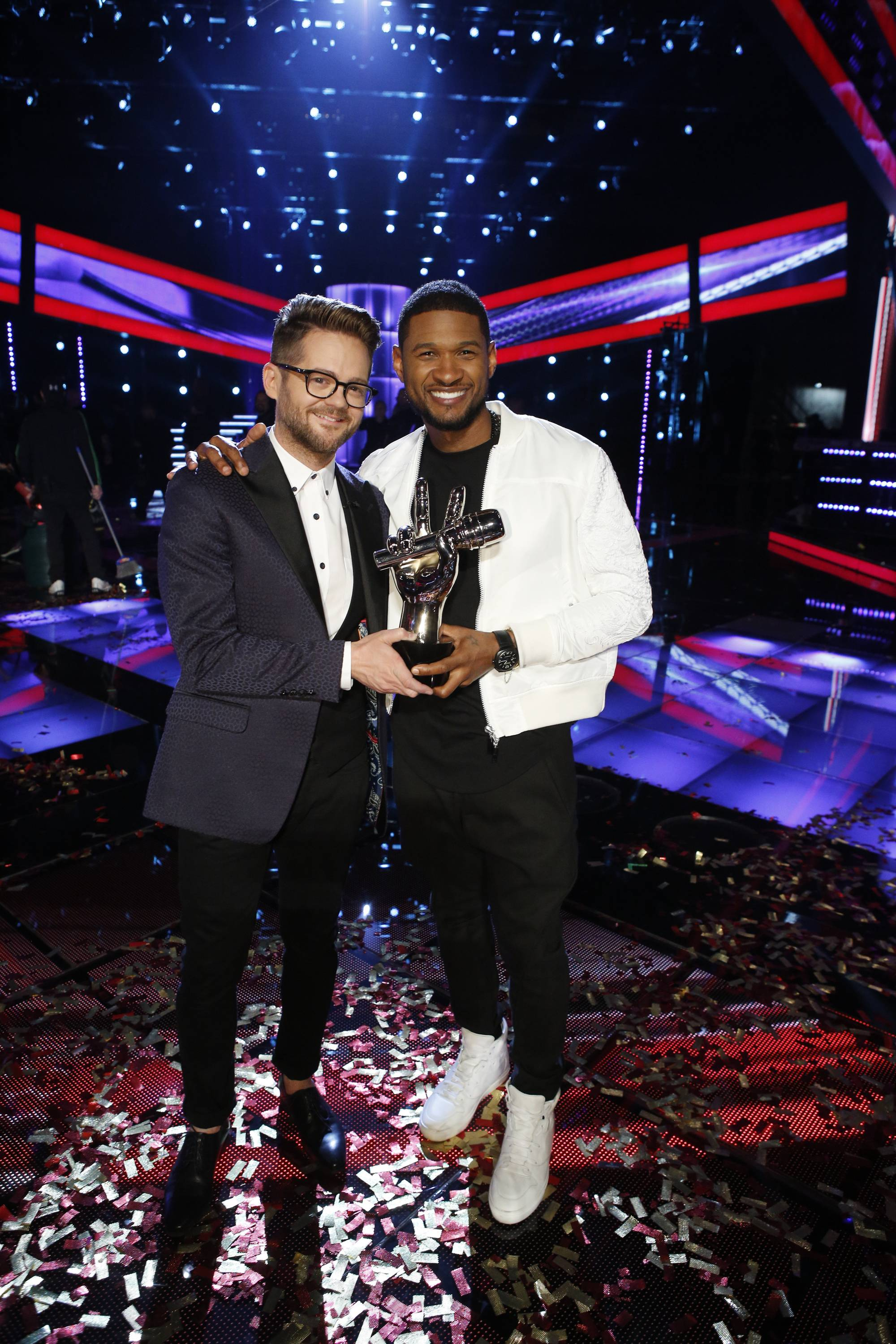 "Josh Kaufman, left, poses with his trophy with Usher after the 38-year-old from team Usher was crowned the season six winner of NBC's ""The Voice"" Tuesday."
