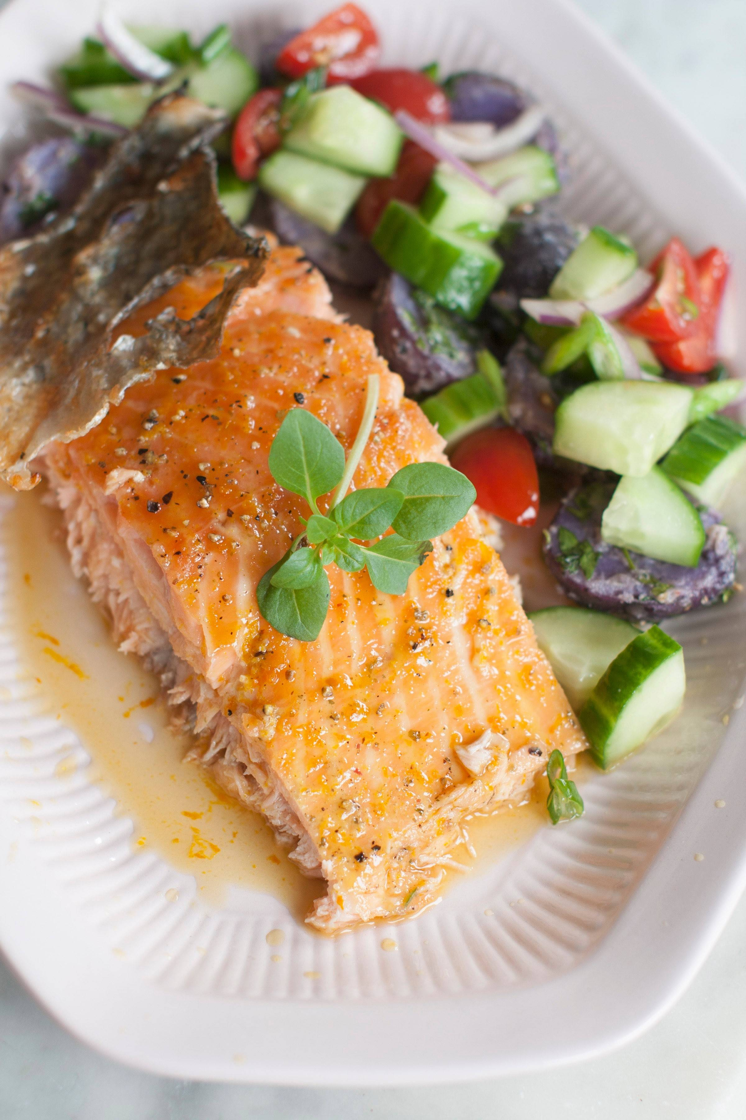 A bourbon-maple glaze brushed on a salmon fillet near the end of grilling time makes for a flavorful feast.