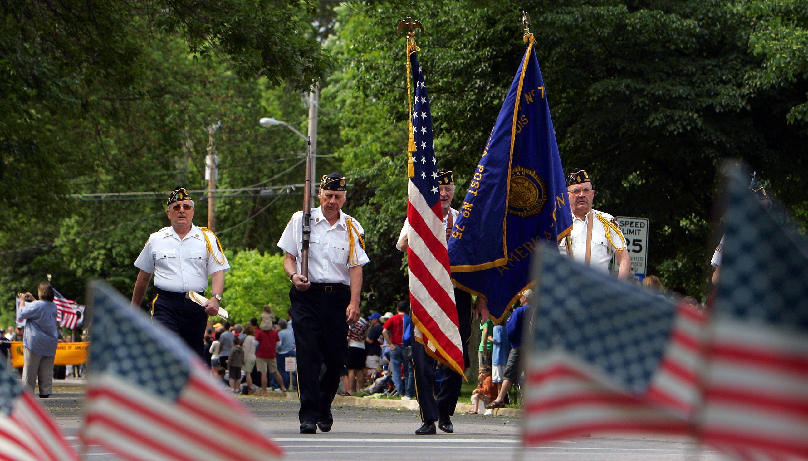 Members of American Legion Post 75 walk the parade route during a previous Geneva Memorial Day parade and gathering at the West Cemetery.