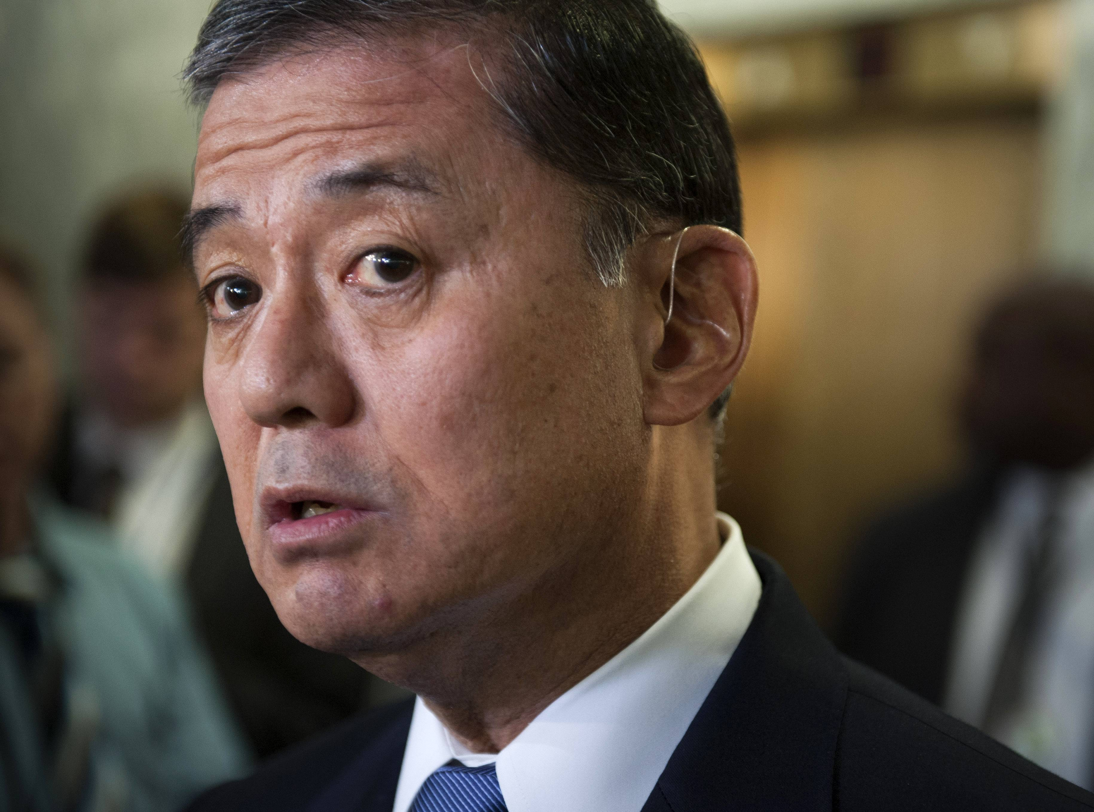 Veterans Affairs Secretary Eric Shinseki is under pressure to correct problems within his agency, while some critics have called on him to resign.