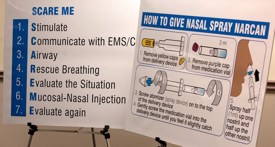 In this February 2014 photo, DuPage County health officials train local police officers on how to administer Narcan, a drug that reverses the effects of heroin. Now, officials in Kane County want follow in DuPage County's foosteps and equip and train police officers on administering Narcan.