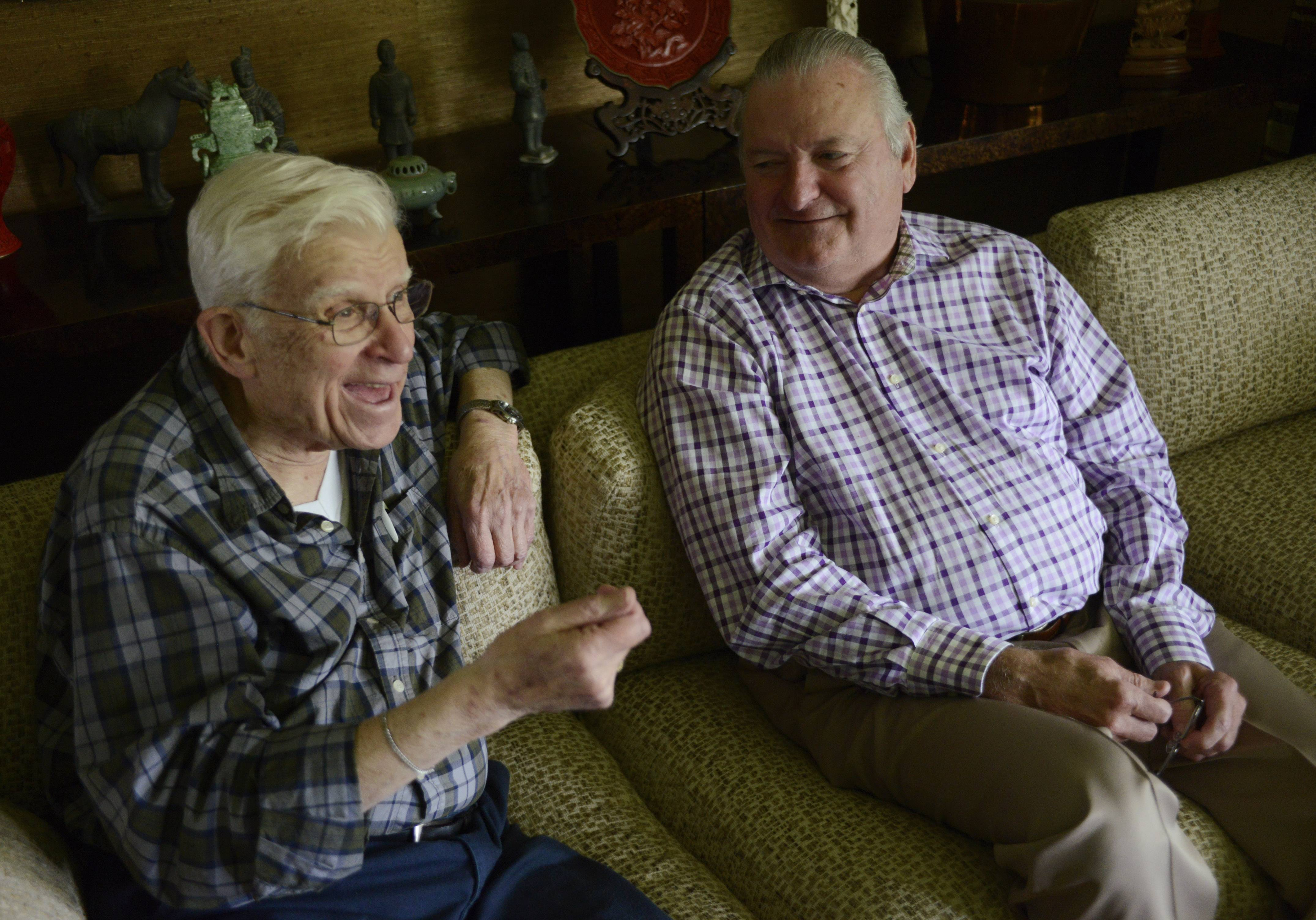 "Burt ""Sarge"" Showers, left, a World War II veteran who served under Gen. Douglas MacArthur and later retired after teaching at two Northwest suburban high schools, now has a scholarship named in his honor. The scholarship, to be given annually to a Palatine High School senior, is funded by former student Ed Rogan, right."