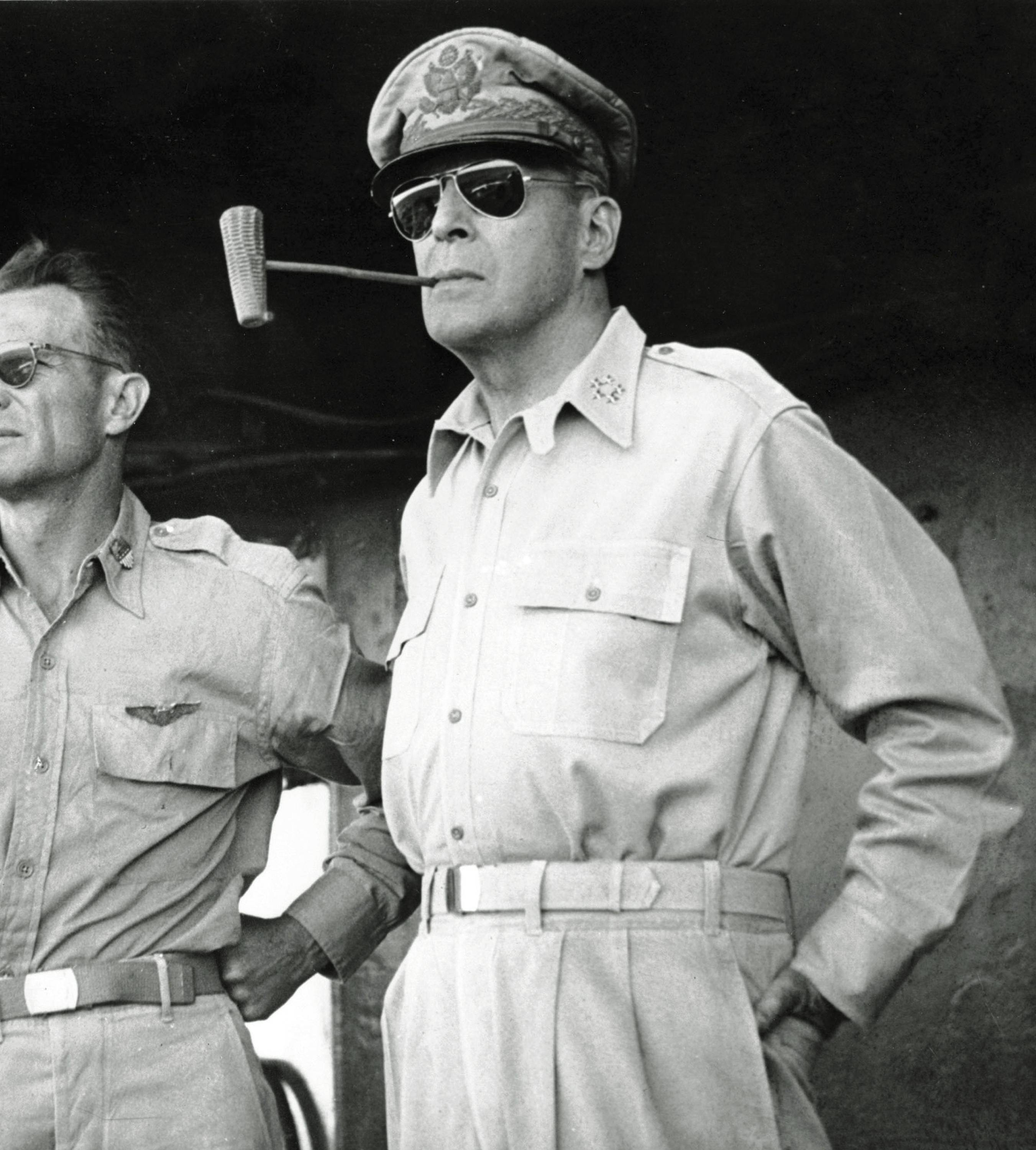 Five-star Gen. Douglas MacArthur smokes one of his trademark corn cob pipes aboard a ship bound for Luzon Island in the Philippines in this Jan. 20, 1945 file photo.