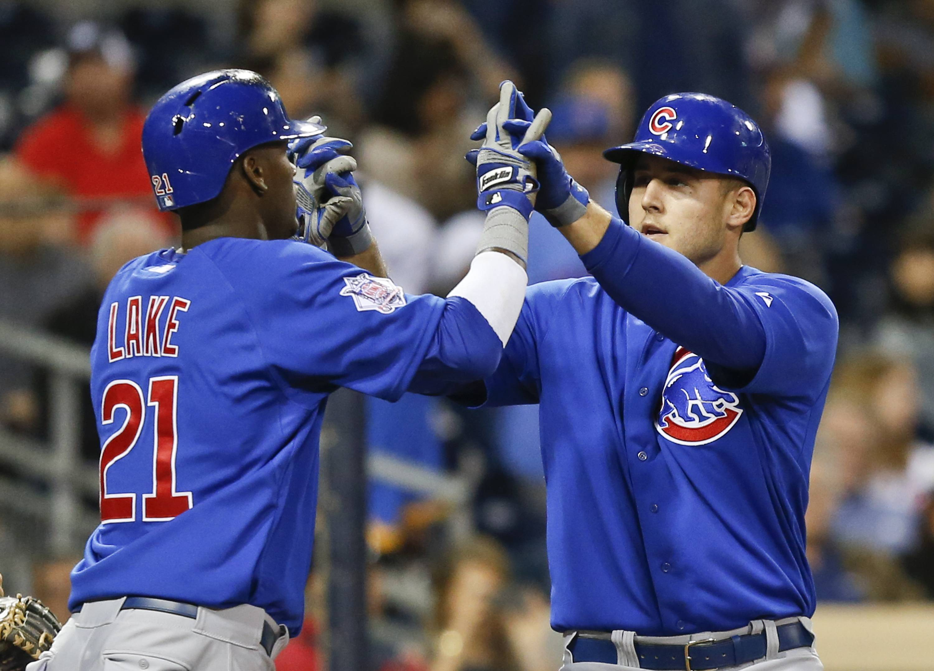 Chicago Cubs' Anthony Rizzo is congratulated by Junior Lake as he crosses home plate with a two run home run against then San Diego Padres in the fourth inning of a baseball game Thursday, May 22, 2014, in San Diego.