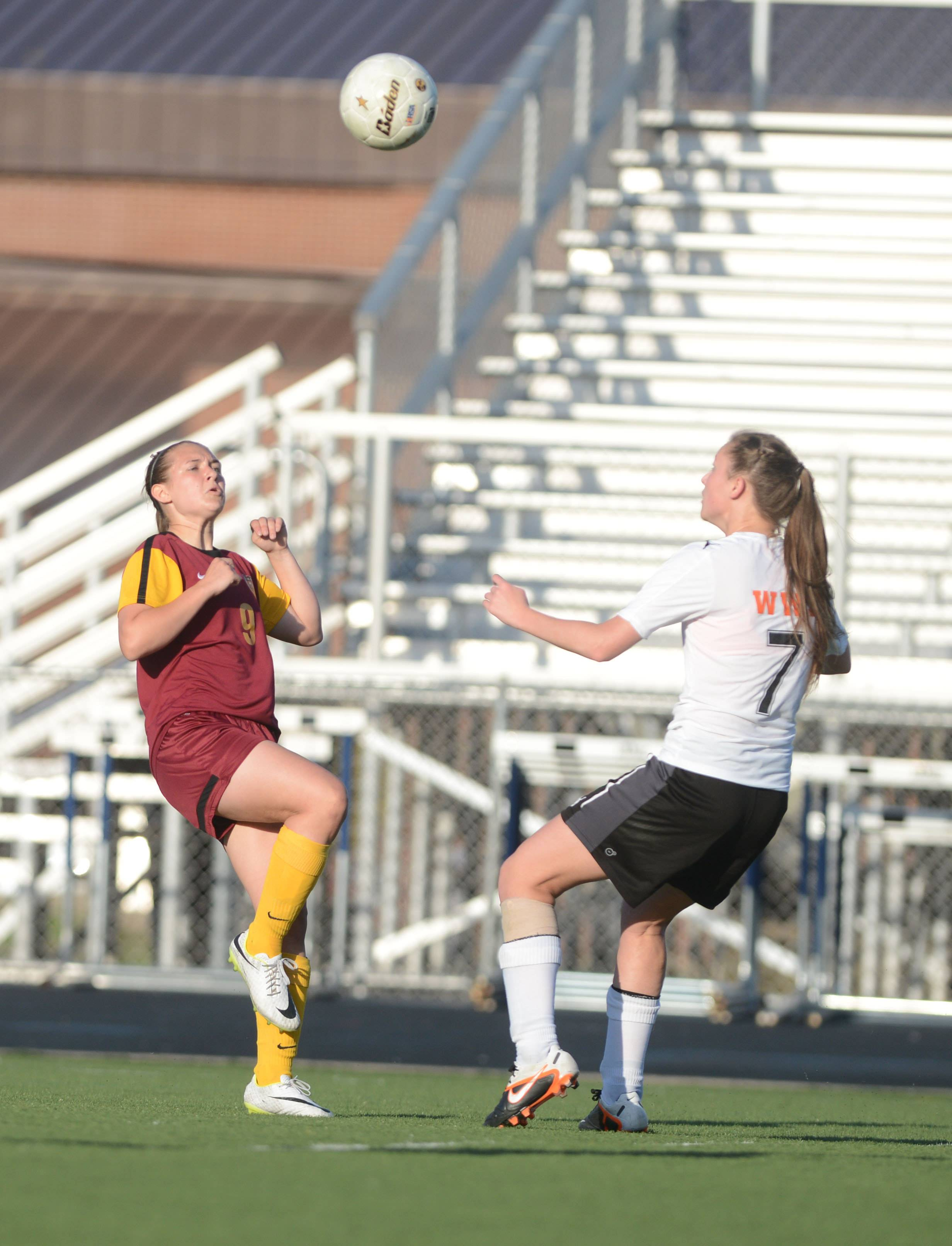 Paul Michna/pmichna@dailyherald.com#9 of Schaumburg (not on roster) and #7 Alexis Jakuszewski go for a head shot during the Wheaton Warrenville South vs. Schaumburg girls soccer at West Chicago regional semifinal game.