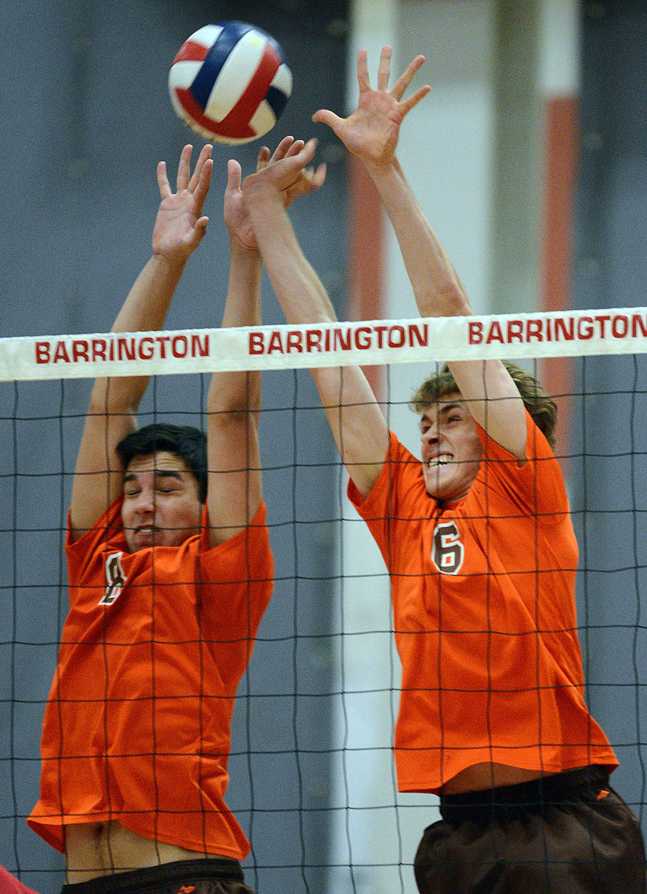 Hersey's Jordan Saeed, left, and Bart Migus block the ball against Barrington during Wednesday's MSL championship match.