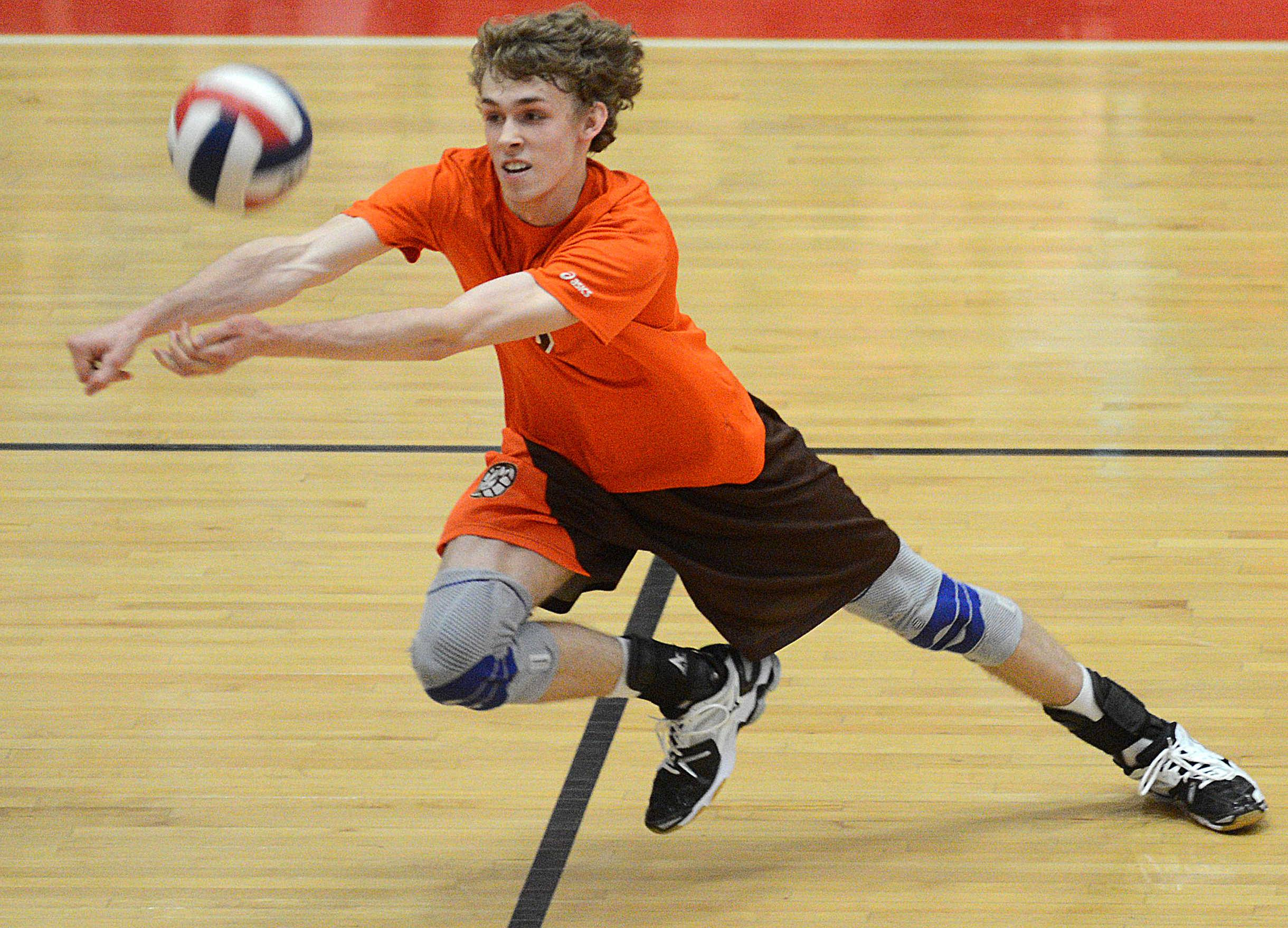 Hersey's Bart Migus dives for the ball during Wednesday's MSL championship match.