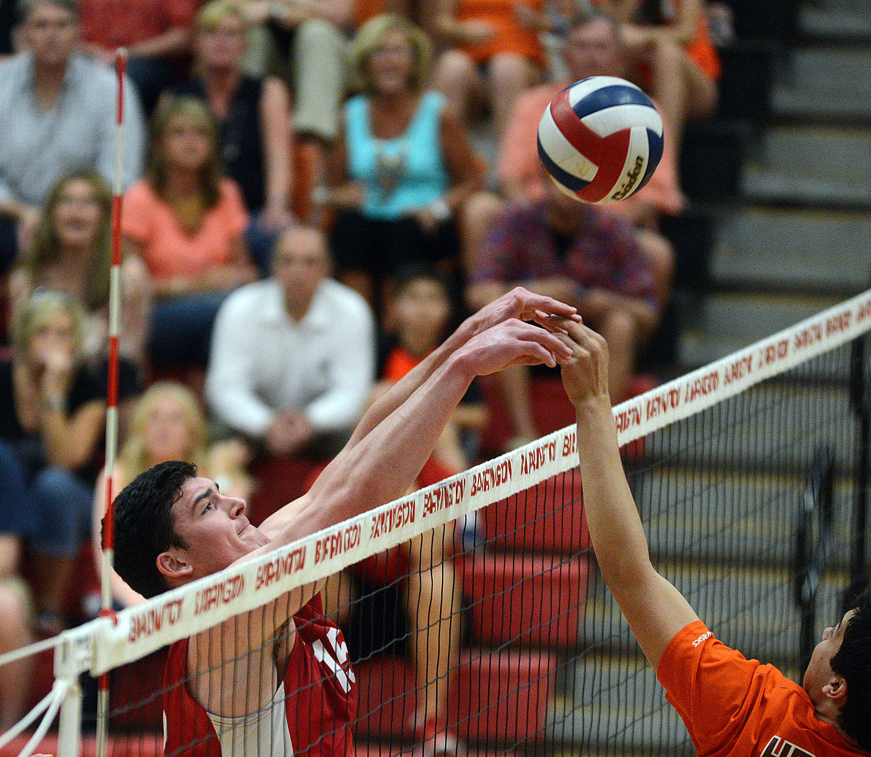 Barrington's Colin Castagna, left, battles at the net with Hersey's Jordan Saeed, right, during Wednesday's MSL championship match.