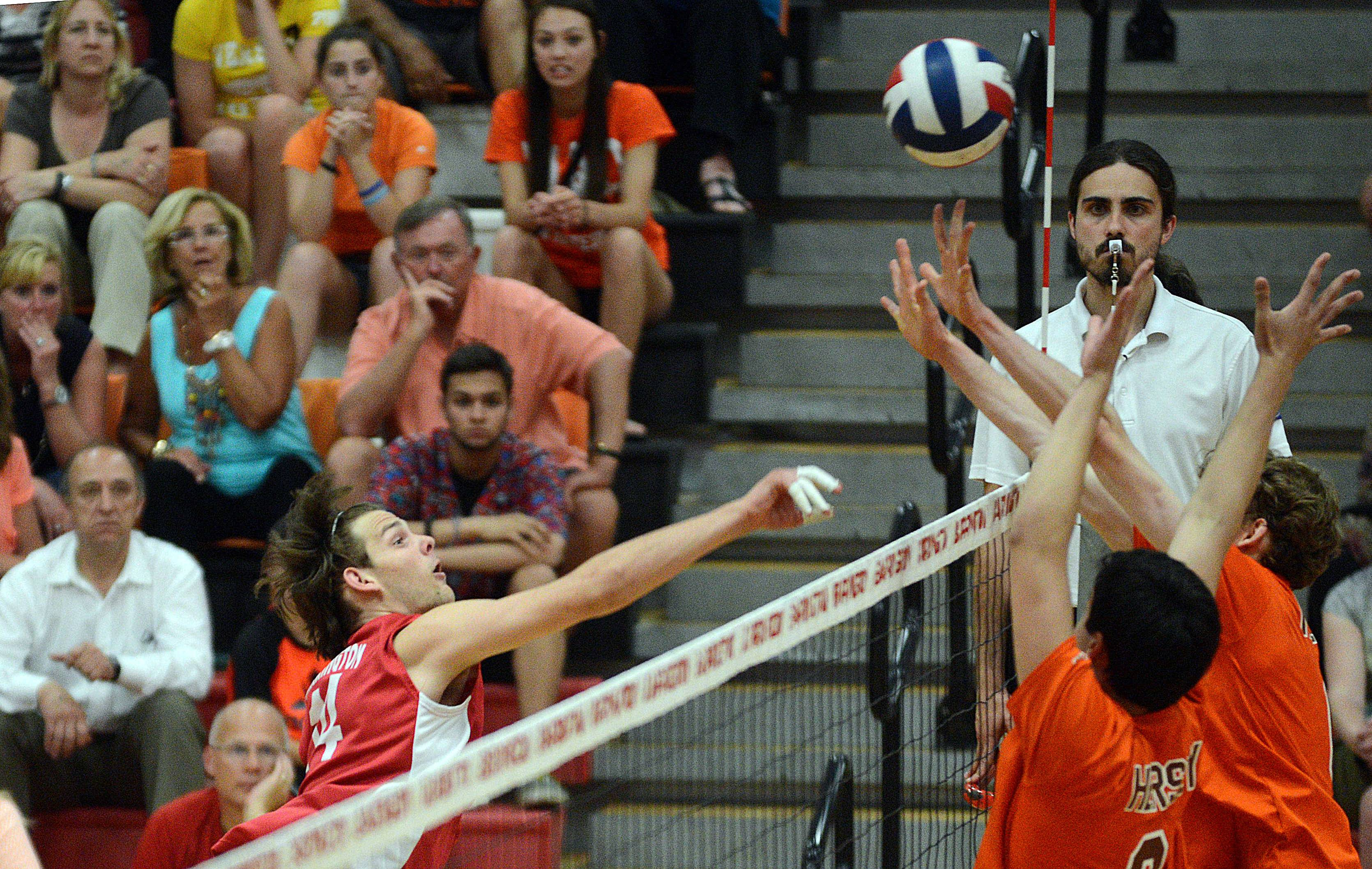 Barrington's Justin Glader hits the ball past Hersey blockers during Wednesday's MSL championship match.