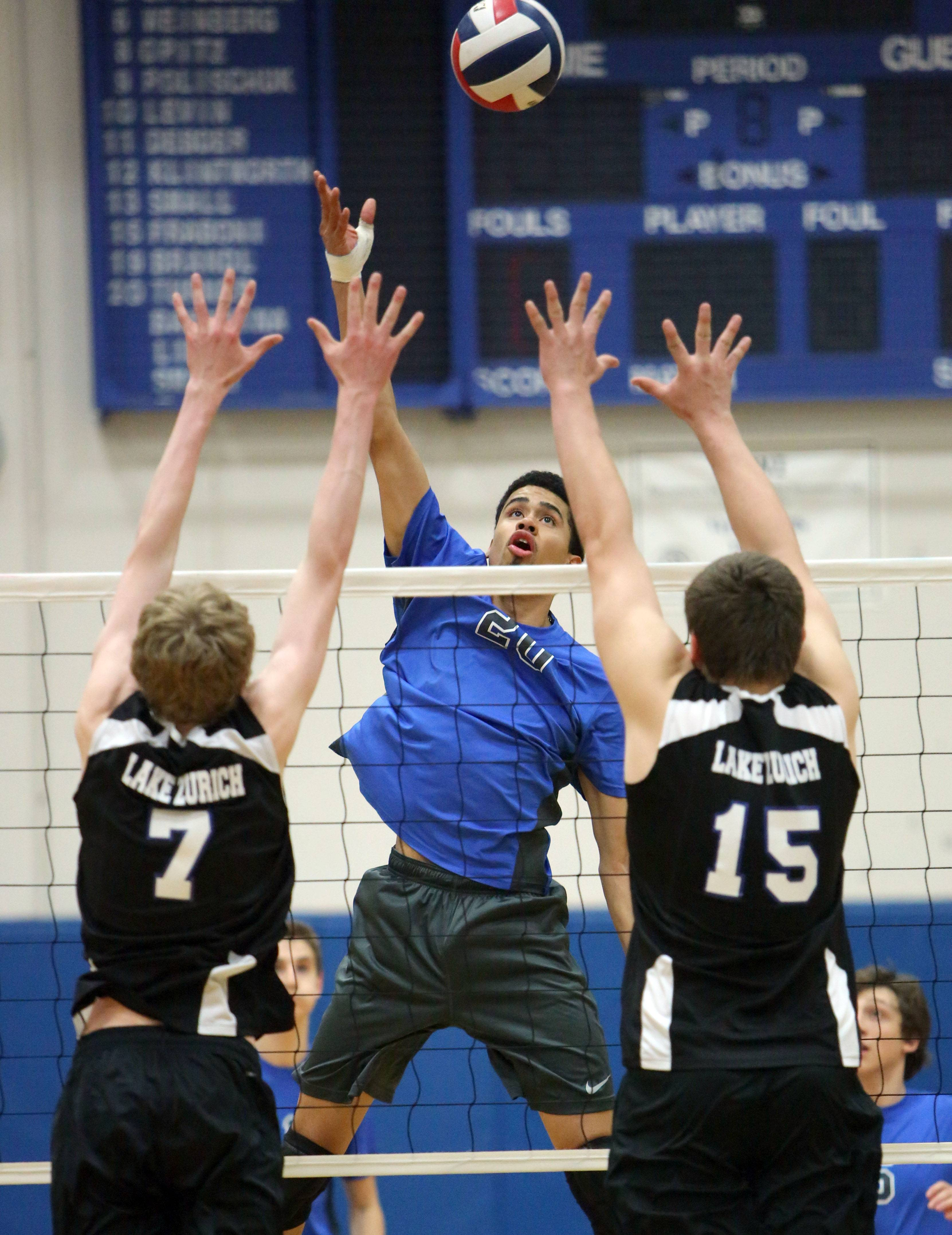 Vernon Hills' Lem Turner, middle, meets Lake Zurich's Matt Carmody, left, and Nate Amos at the net Wednesday at Vernon Hills.