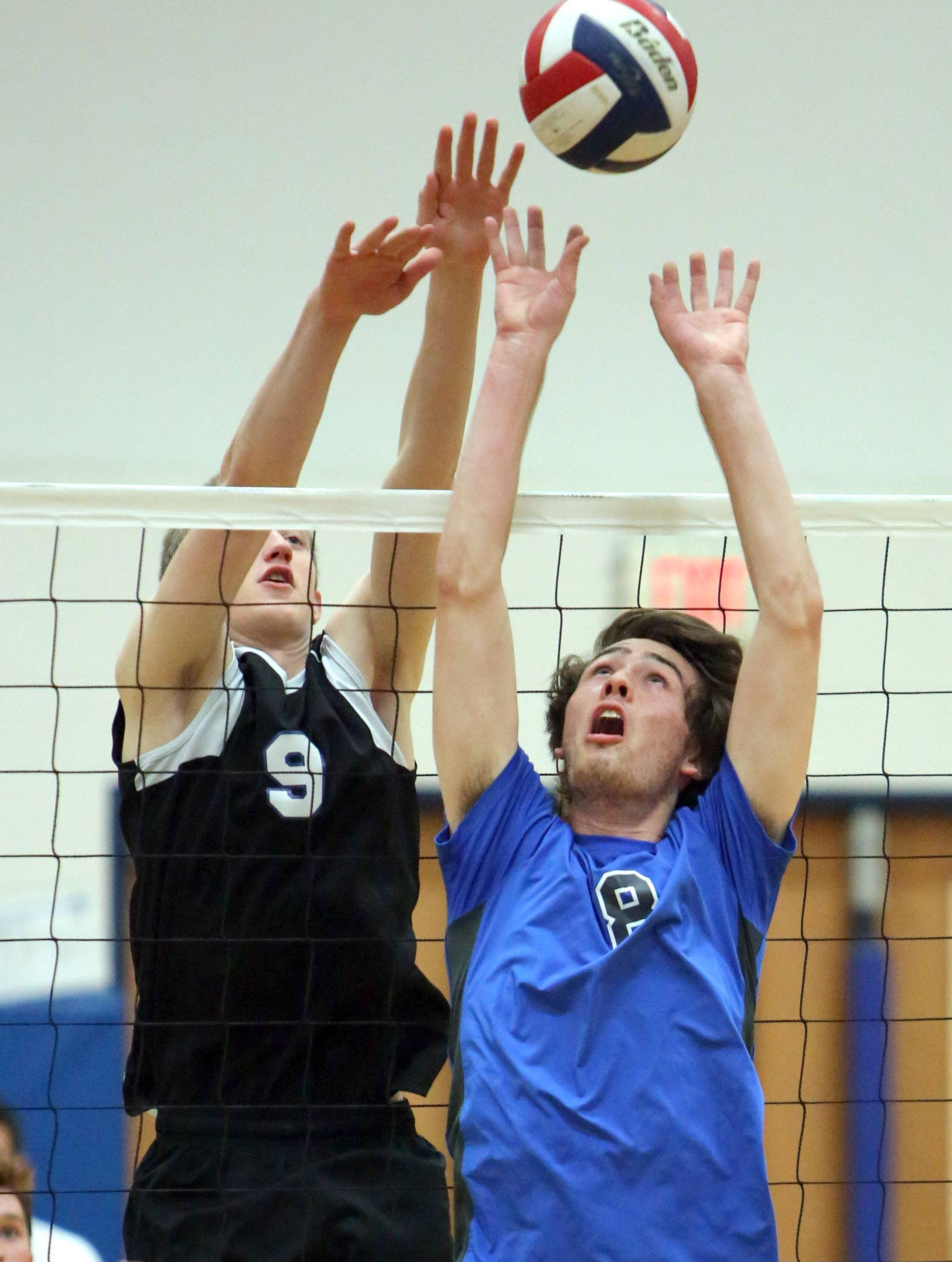 Vernon Hills' Ryan Opitz, right, and Lake Zurich's Nick Meyer meet at the net Wednesday at Vernon Hills.