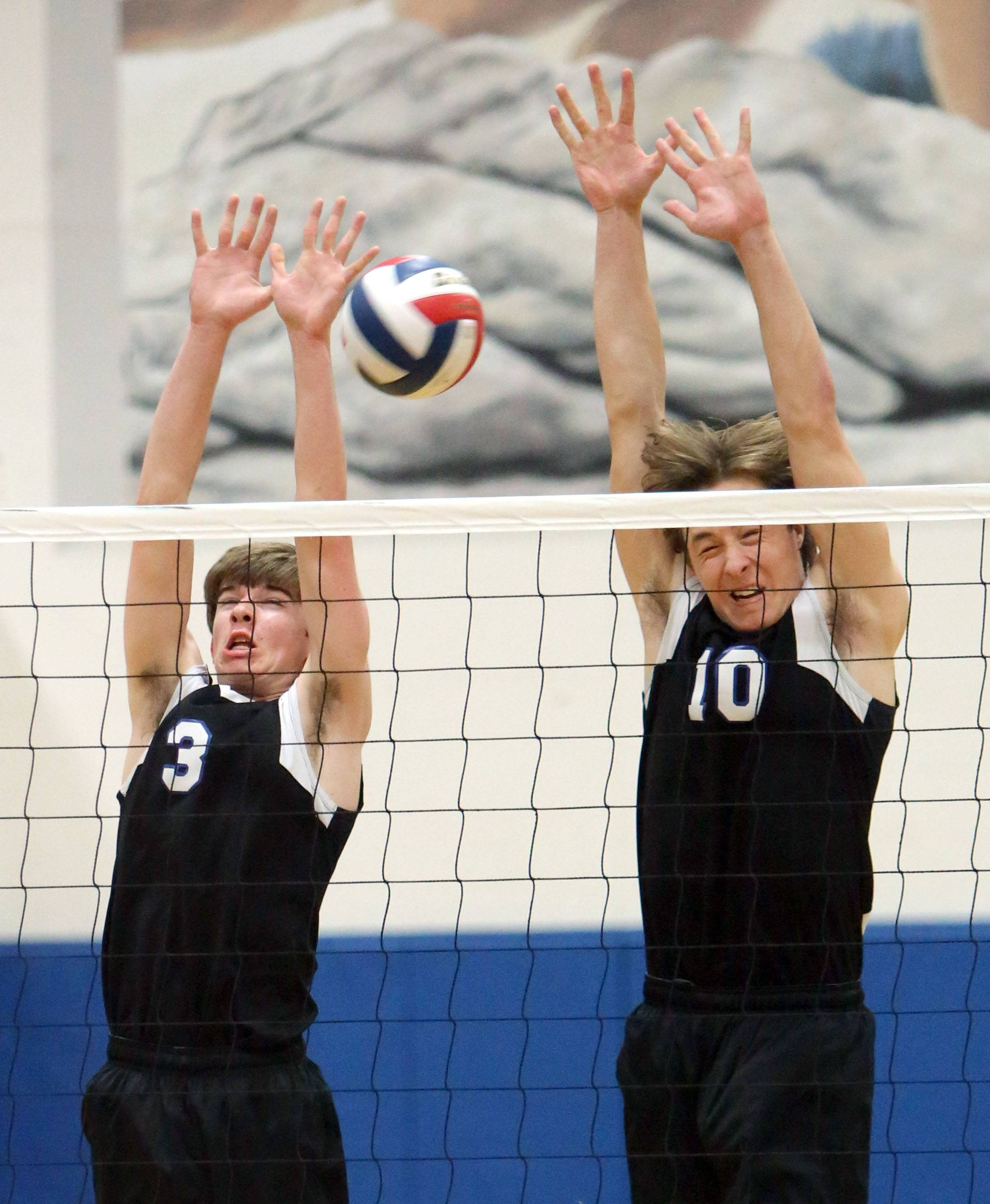 Lake Zurich's Pat Bush, left, and Brent Sweetwood go up for a block Wednesday at Vernon Hills.