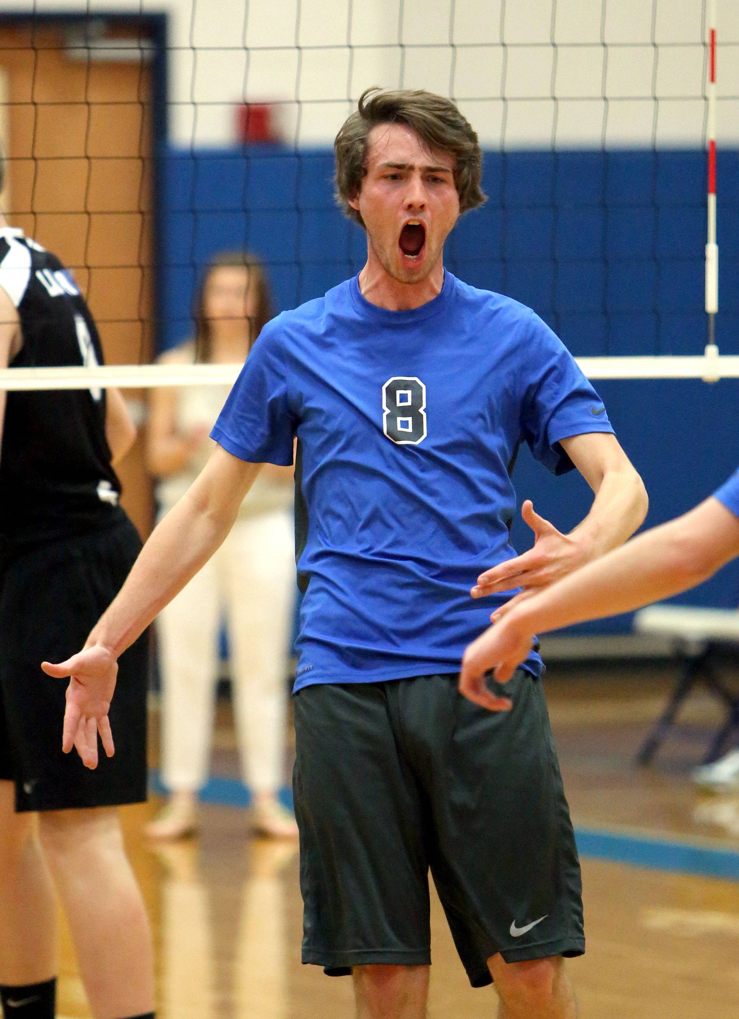 Vernon Hills' Ryan Opitz celebrates after a point during the Cougars' win over Lake Zurich on Wednesday at Vernon Hills.